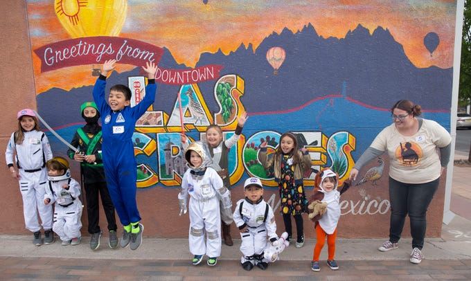 Joaquin Hernandez, 10, jumps with enthusiasm during the second Space Walk Friday April 12, 2019, in Las Cruces. Hernandez, dressed as an astronaut, and his sister Milana, 7, dressed as the solar system, won first prize in the event's costume contest, Friday April 12, 2019.
