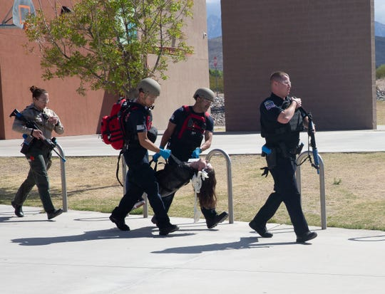 "A ""victim"" is carried to safety by first responders Saturday April 13, during an active shooter training at Arrowhead Park Early College High School."