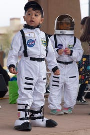 Two of the littlest astronauts — Canelo Gonzalez, 3, and Sophia Tellez, 5, — have fun at the second Space Walk, held Friday April 12, 2019, in downtown Las Cruces.