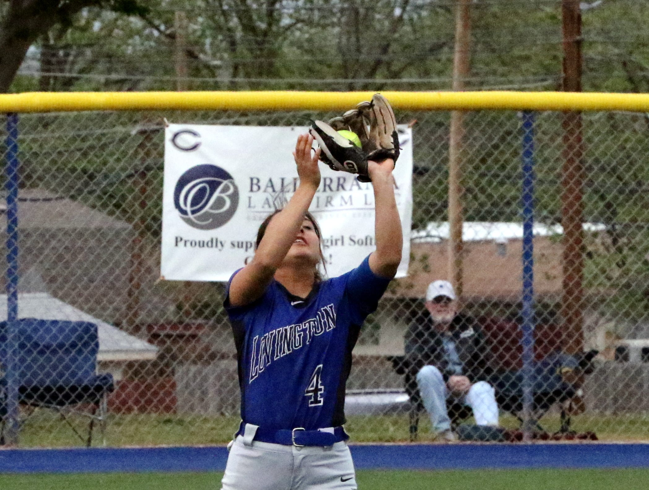 Lovington's Hayley Marquez records a flyout against Carlsbad in the first game of Friday's doubleheader.