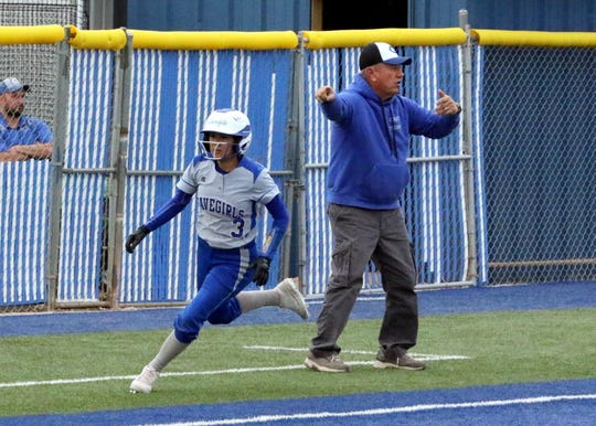 Cavegirl Marissa Reyes sprints home to score one of Carlsbad's six runs in the fifth inning of Game 1 against Lovington on April 12, 2019.