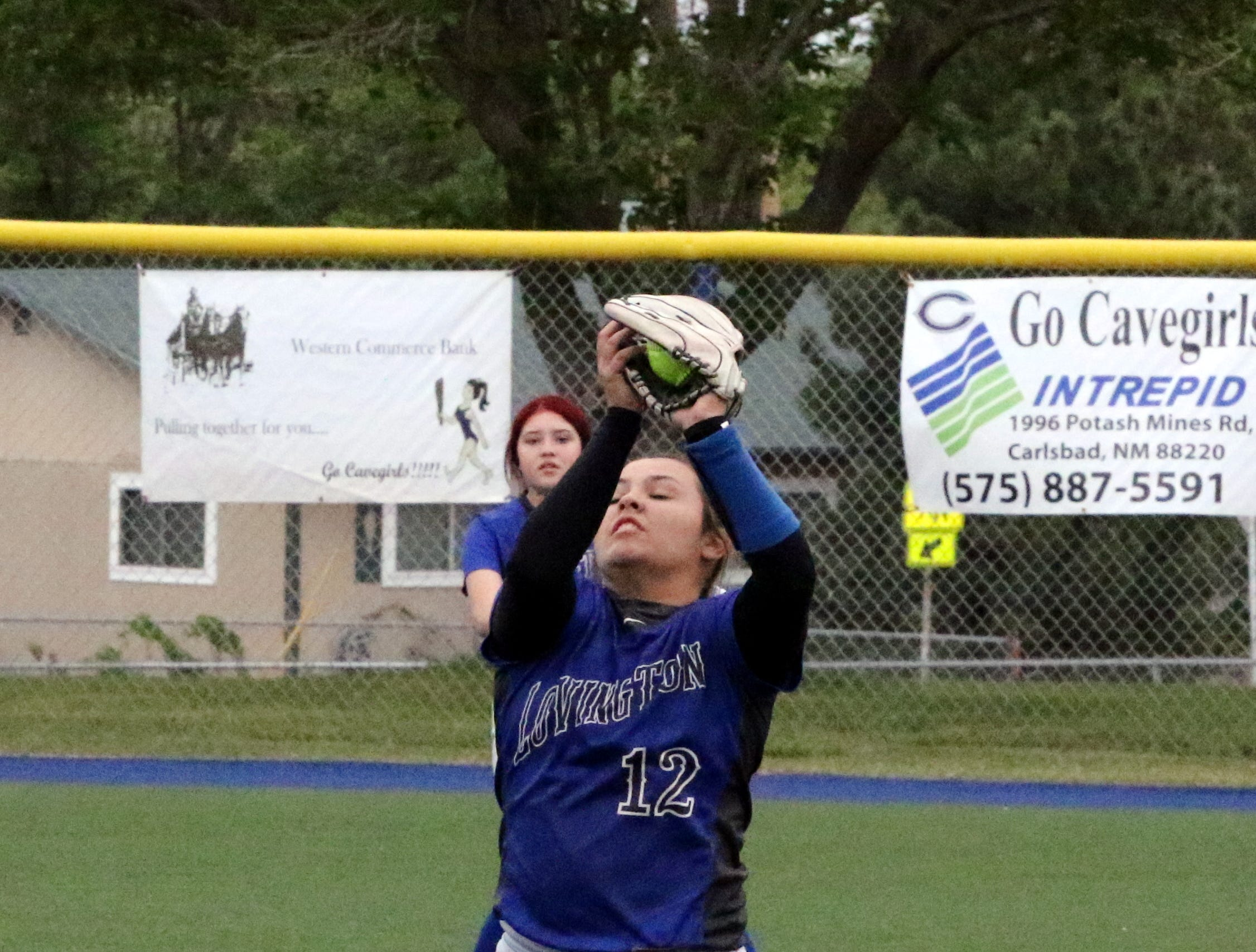 Lovington's Addy Marquez records a flyout against Carlsbad in the first game of Friday's doubleheader.
