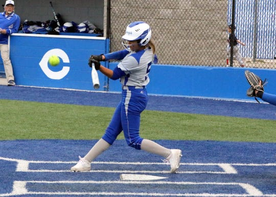 Carlsbad's Gabby Aragon connects with a pitch she would turn into an RBI triple in Game 1 of a doubleheader against Lovington on April 12, 2019.