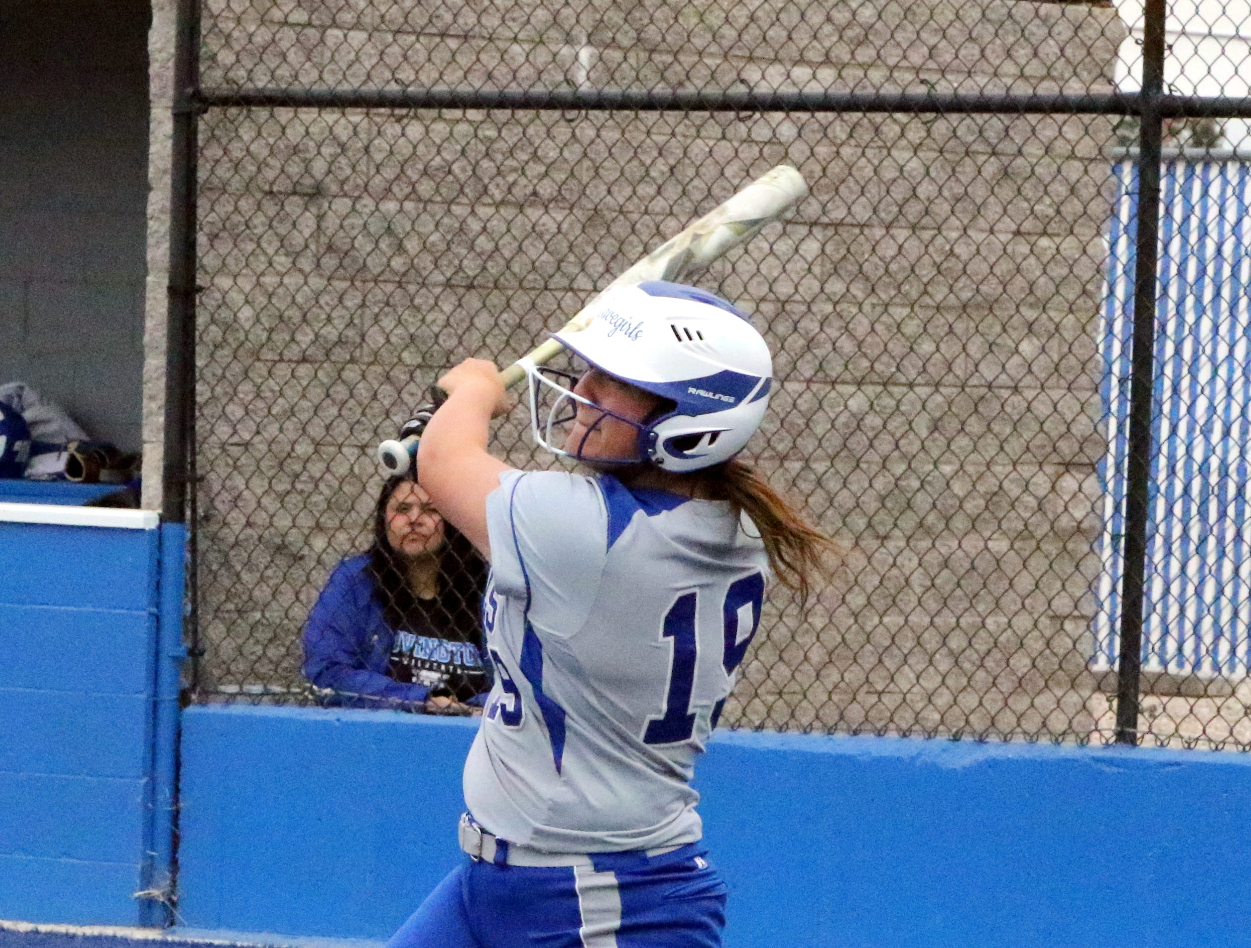 Taighen Whitzel watches her sixth inning hit smack the outfield wall. Whitzel turned the hit into an RBI double.