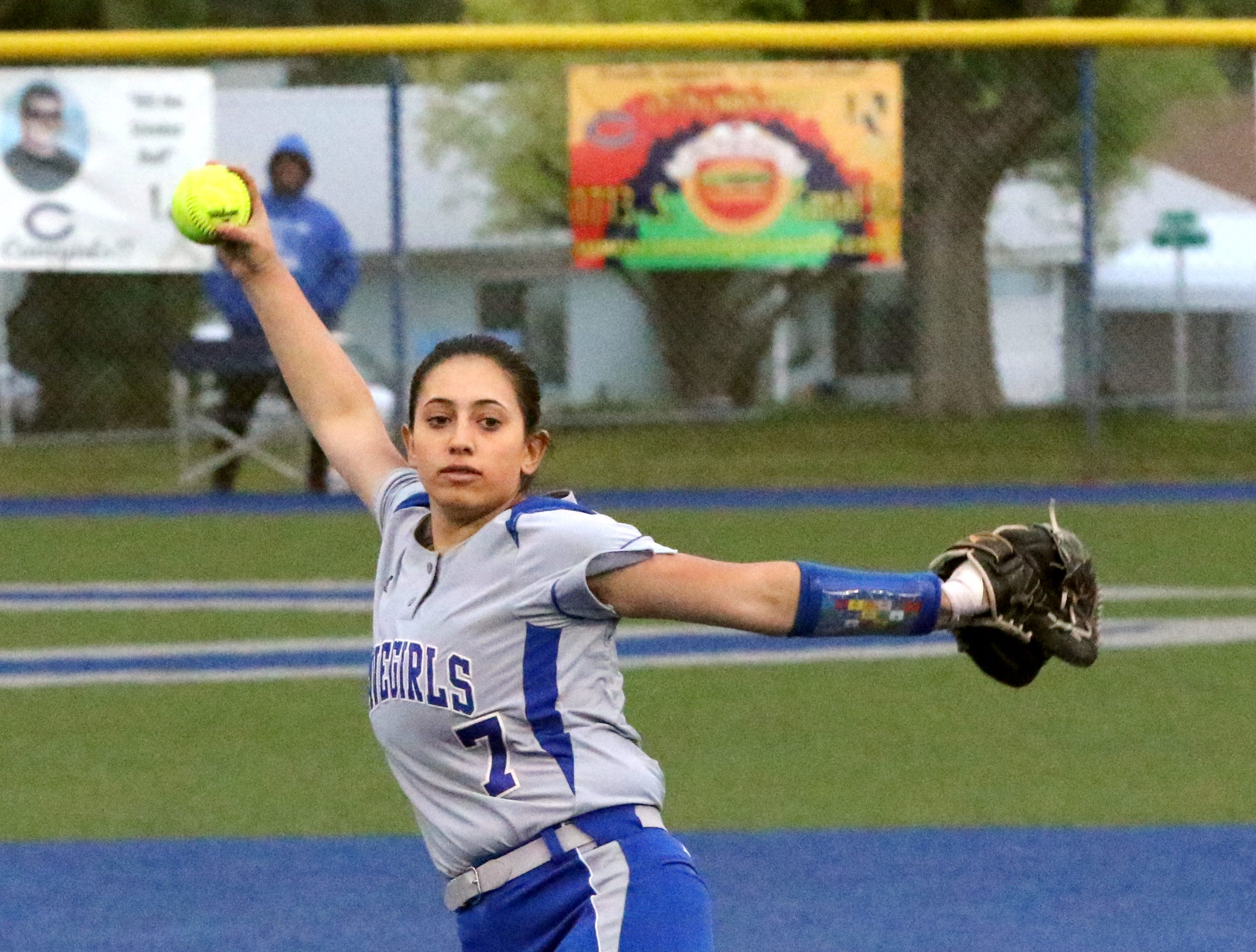 Cavegirl Ashley Hernandez pitches in Game 2 against Lovington. Hernandez threw a complete game, allowing three runs, two earned, in five innings. She threw 86 pitches in the 13-3 win.