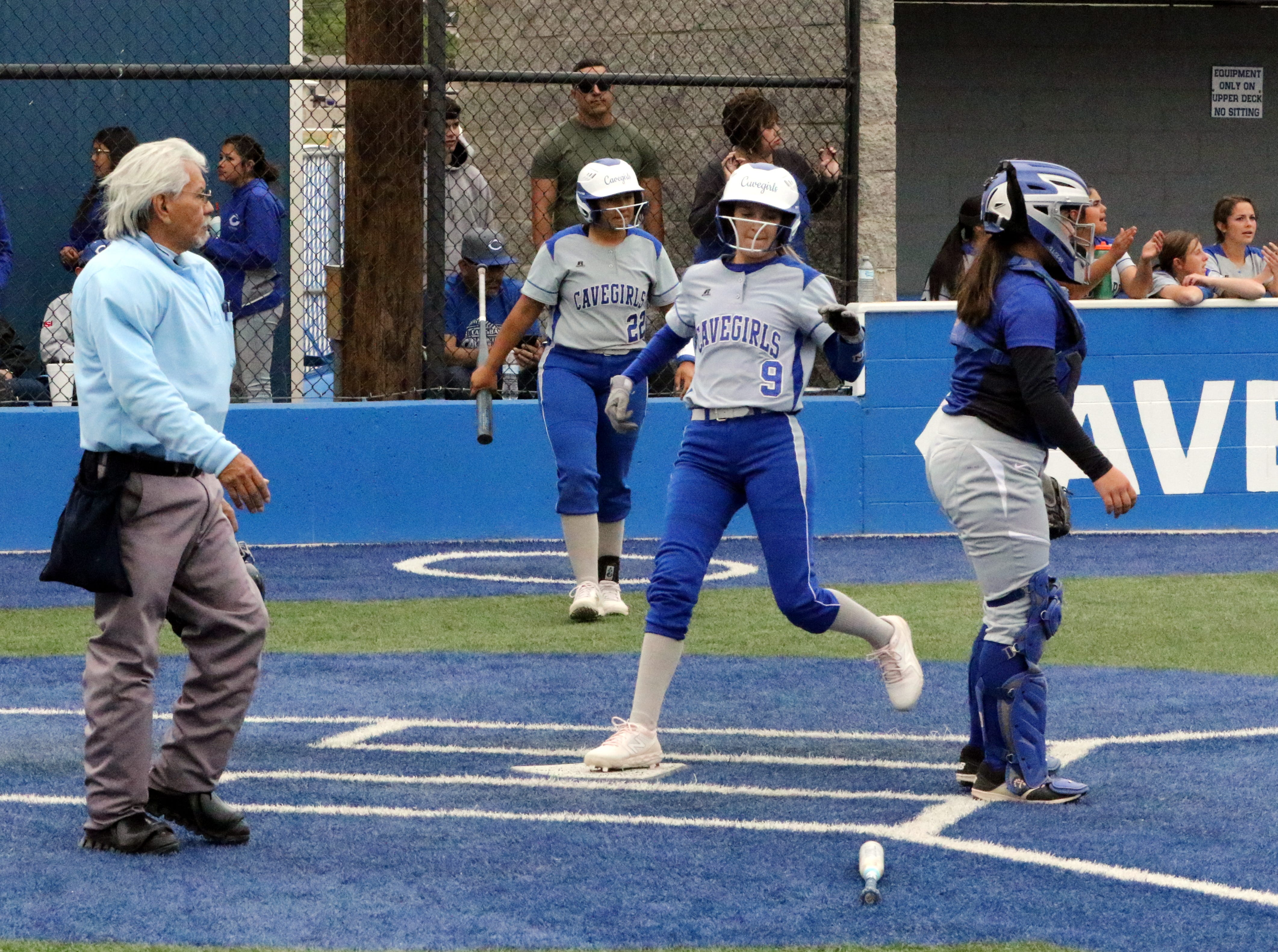Jennifer Munro crossed home plate to score one of Carlsbad's six runs in the fifth inning of Game 1 against Lovington.