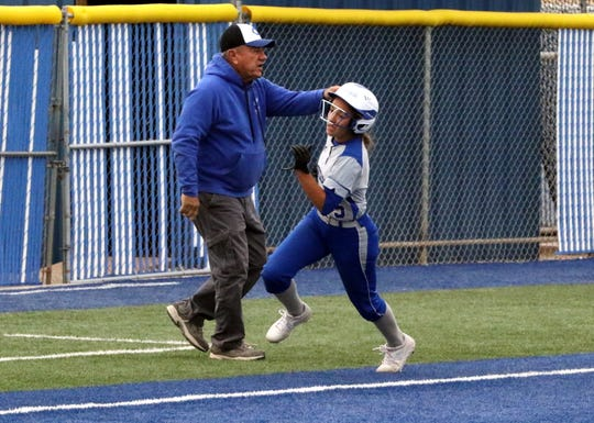 Gabby Aragon races home to score against Loving on April 12. Aragon led the Cavegirls in batting average and is one of the three Cavegirls to represent Eddy County in the Southeast Large School All-Star team.