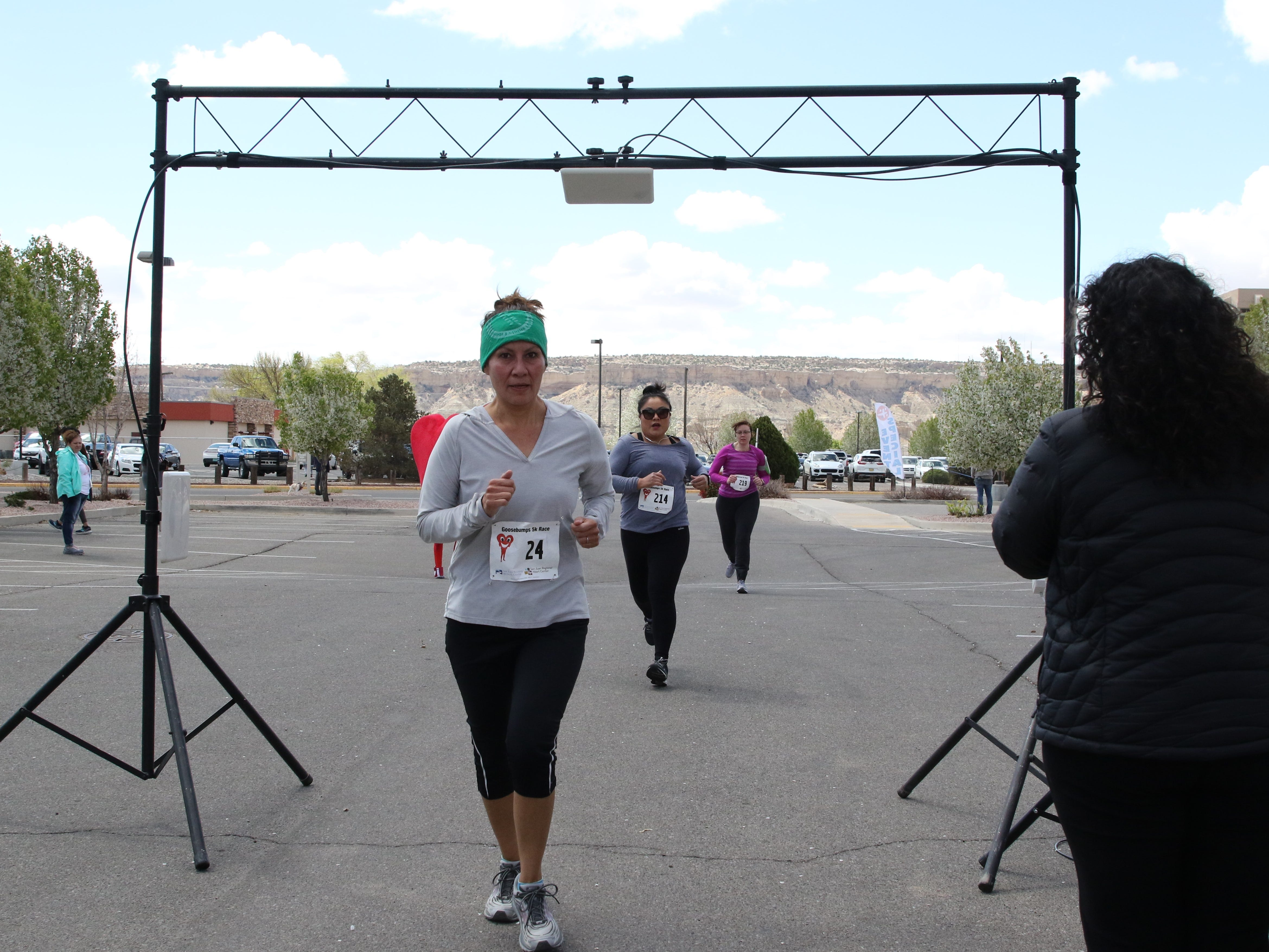 A trio of runners finish the 5K race for the 11th annual A Fair of the Heart and Goosebump Race on Saturday in Farmington.