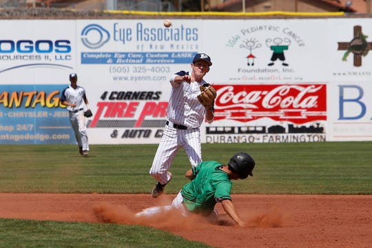 Piedra Vista's Kason Foster throws to first base to complete a 6-4-3 double play against Farmington during Saturday's District 2-5A game at Ricketts Park in Farmington.