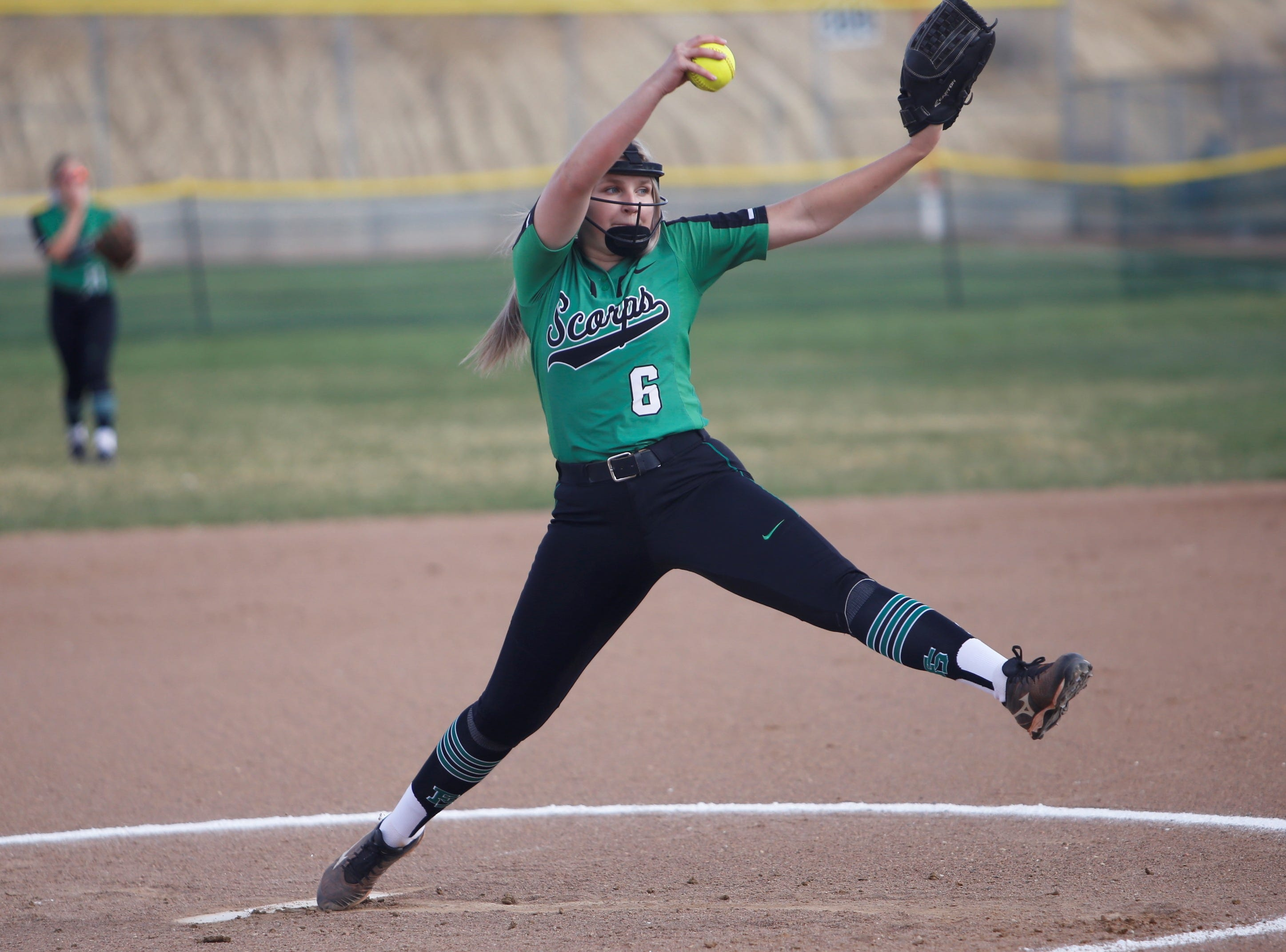 Farmington's Makayla Donald throws a strike against Piedra Vista during Friday's District 2-5A game at Farmington Sports Complex.