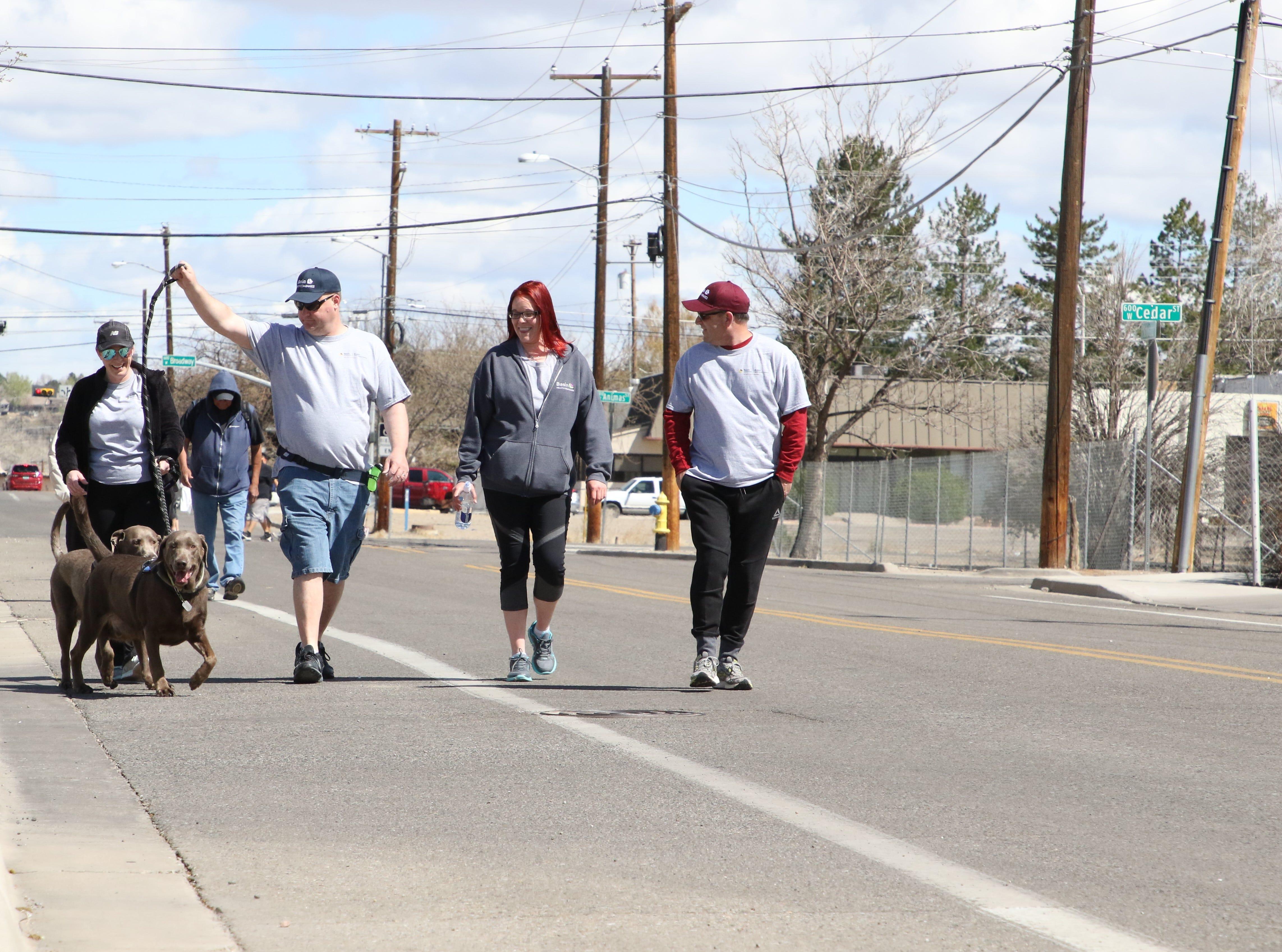 Participants walk near the San Juan Regional Heart Center in Farmington as part of the 11th annual A Fair of the Heart and Goosebump Race on Saturday.