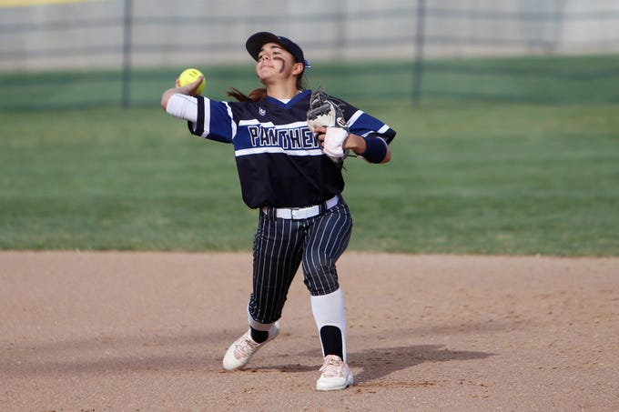 Piedra Vista's Jade Skaggs throws to first base for an out against Farmington during Friday's District 2-5A game at Farmington Sports Complex.