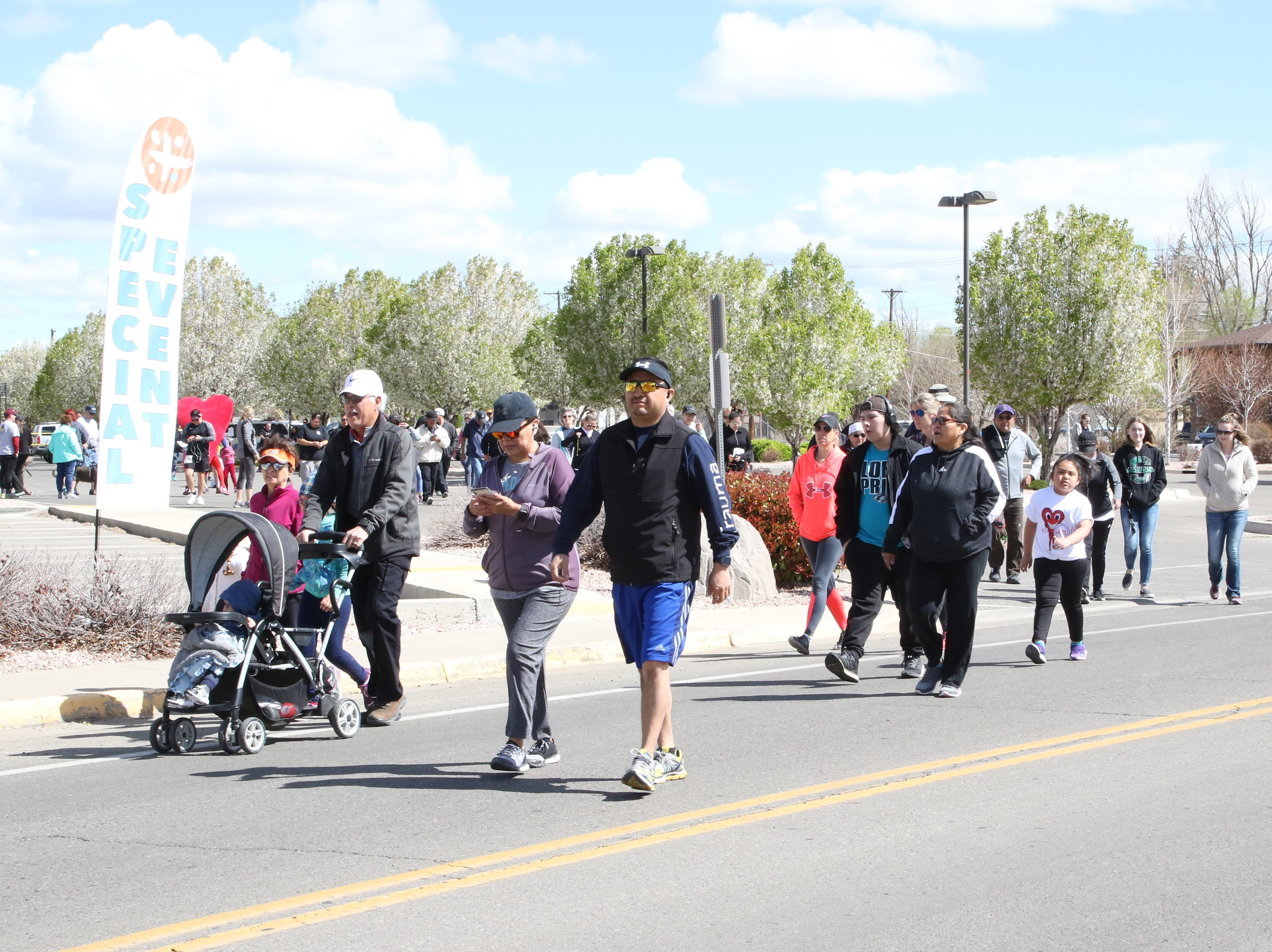 Participants in the 11th annual A Fair of the Heart and Goosebump Race on Saturday leave the San Juan Regional Heart Center in Farmington.