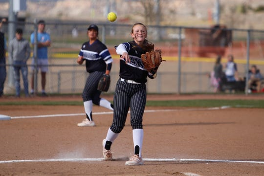 Piedra Vista's Akaysia Grogan retrieves a ground ball to the pitcher's circle and throws to first base for a quick out against Farmington during Friday's District 2-5A game at Farmington Sports Complex.