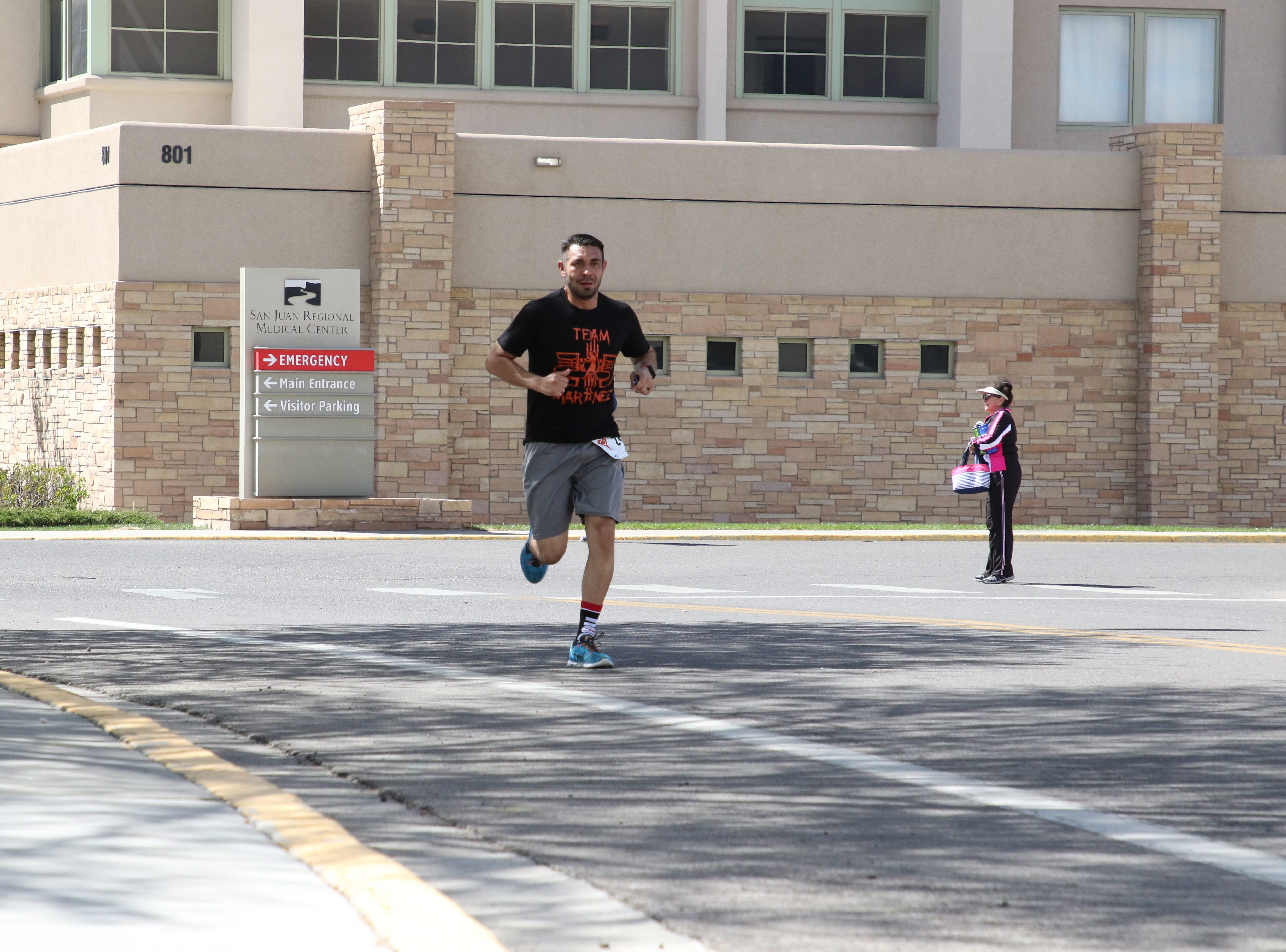 A runner in the 11th annual A Fair of the Heart and Goosebump Race on Saturday passes the San Juan Regional Medical Center in Farmington.