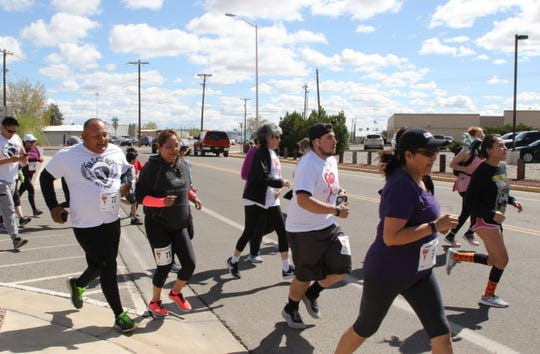 Runners make their way onto South Schwartz Avenue on Saturday as part of the 11th annual A Fair of the Heart and Goosebump Race in Farmington.