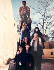 """Luis and Susan Jimenez with their children at the """"Border Crossing"""" installation"""