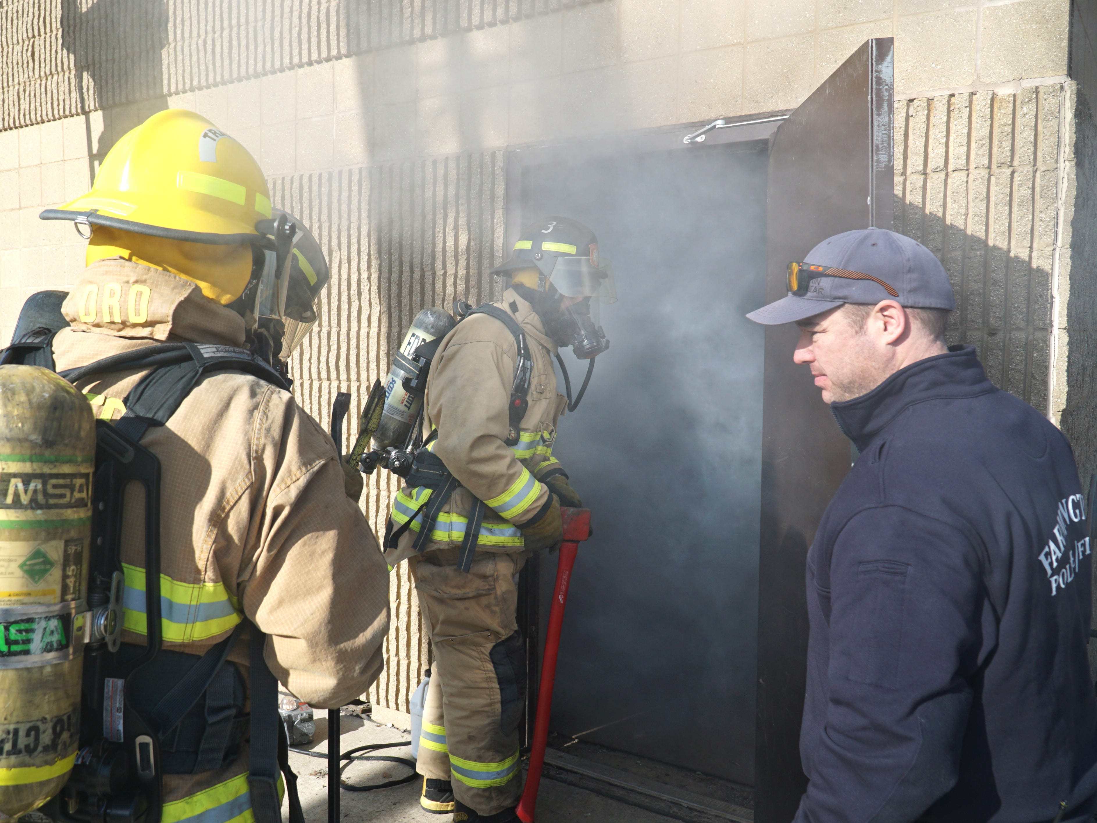 Jim Wren, right, begins to escort trainees into the Farmington Hills DPW smoke-filled fire training house on April 13. Wren will soon become the new Farmington Hills Fire Marshall.