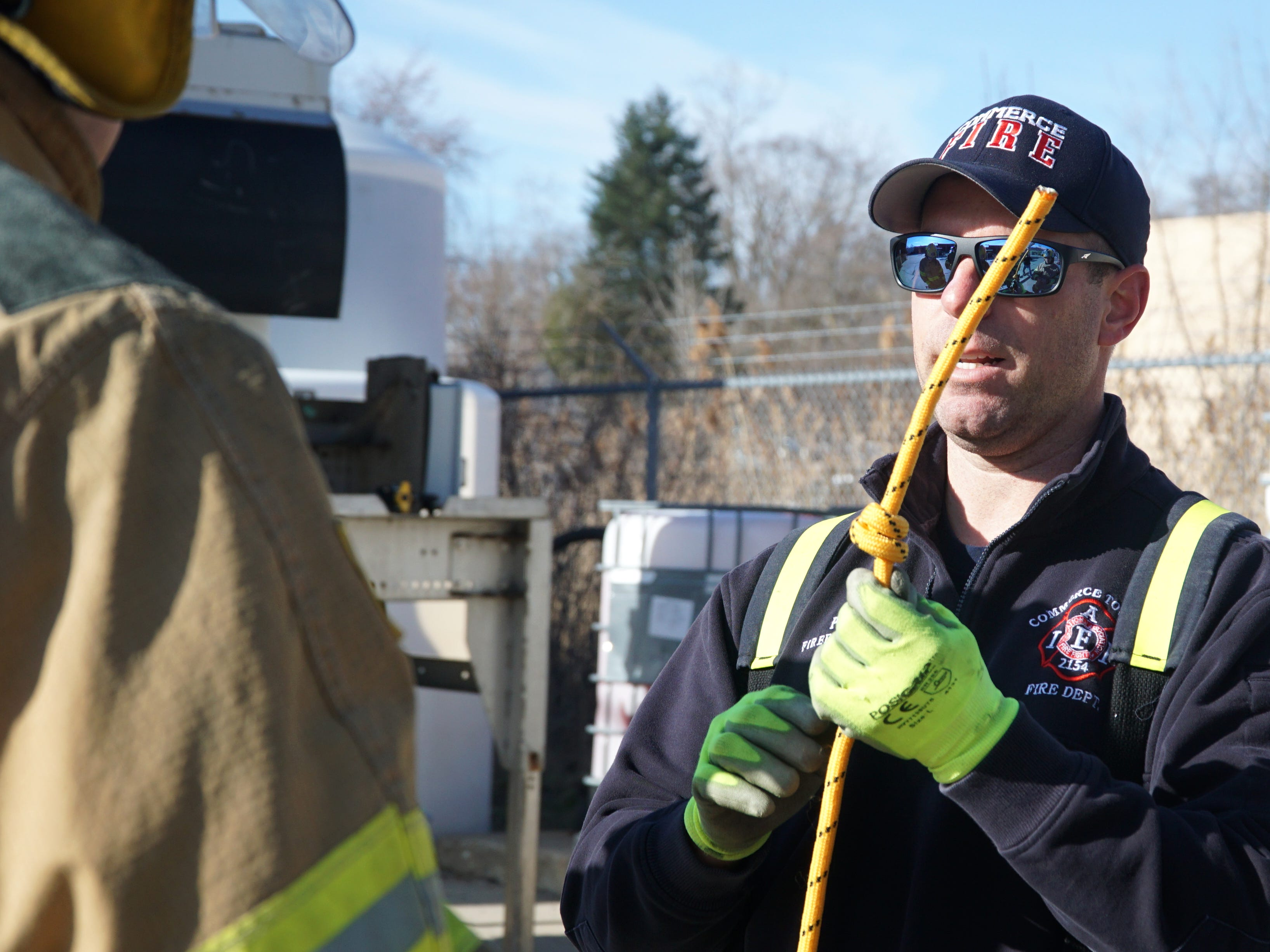 During the training session on April 13 at the Farmington Hills DPW yard Mark Peters - of the Commerce Township Fire Department - was teaching recruits how to tie knots in rope and how to secure their webbing.