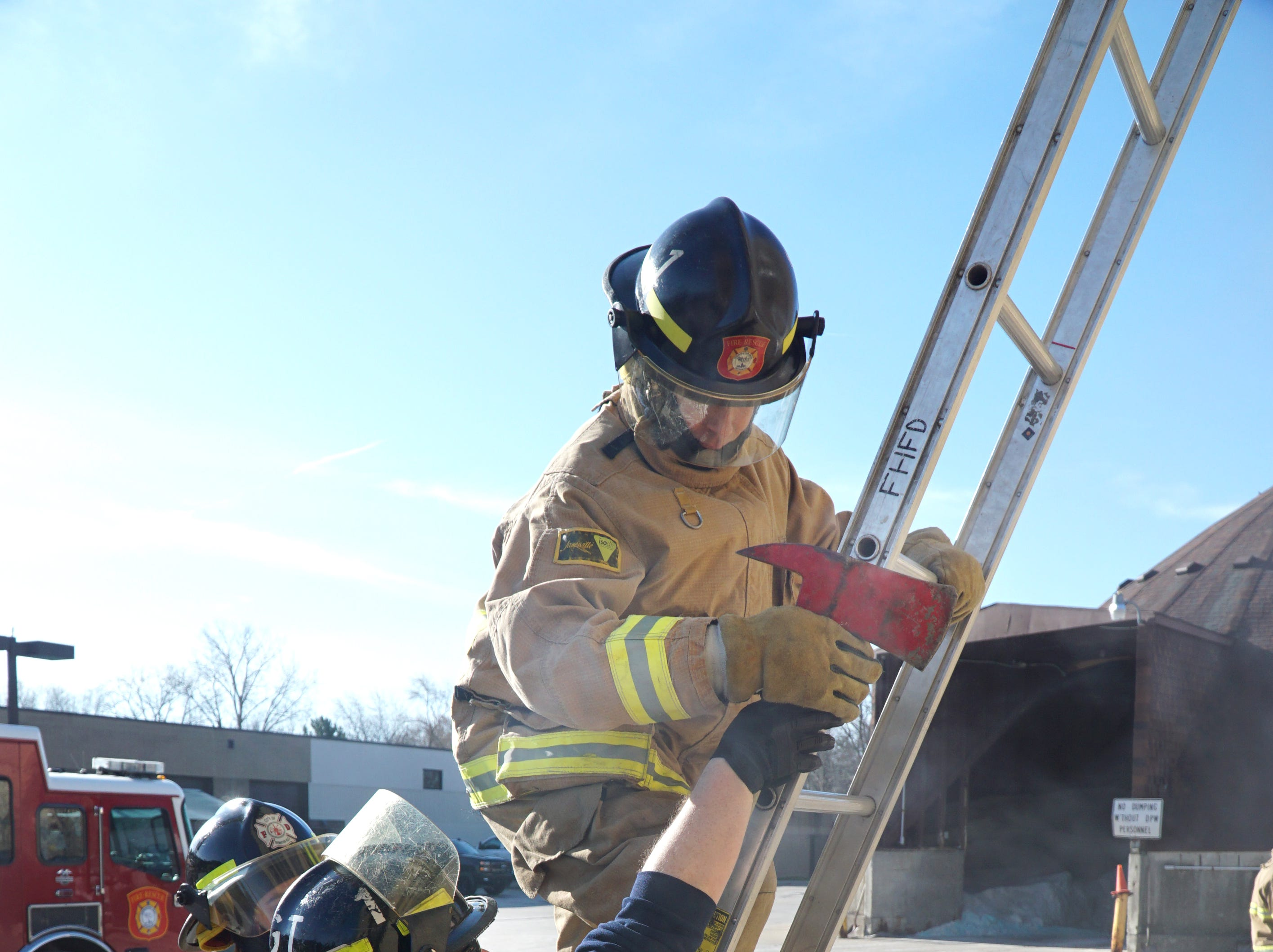 Andrew Staub, center, was teaching recruits how to position and climb ladders while fighting fires.