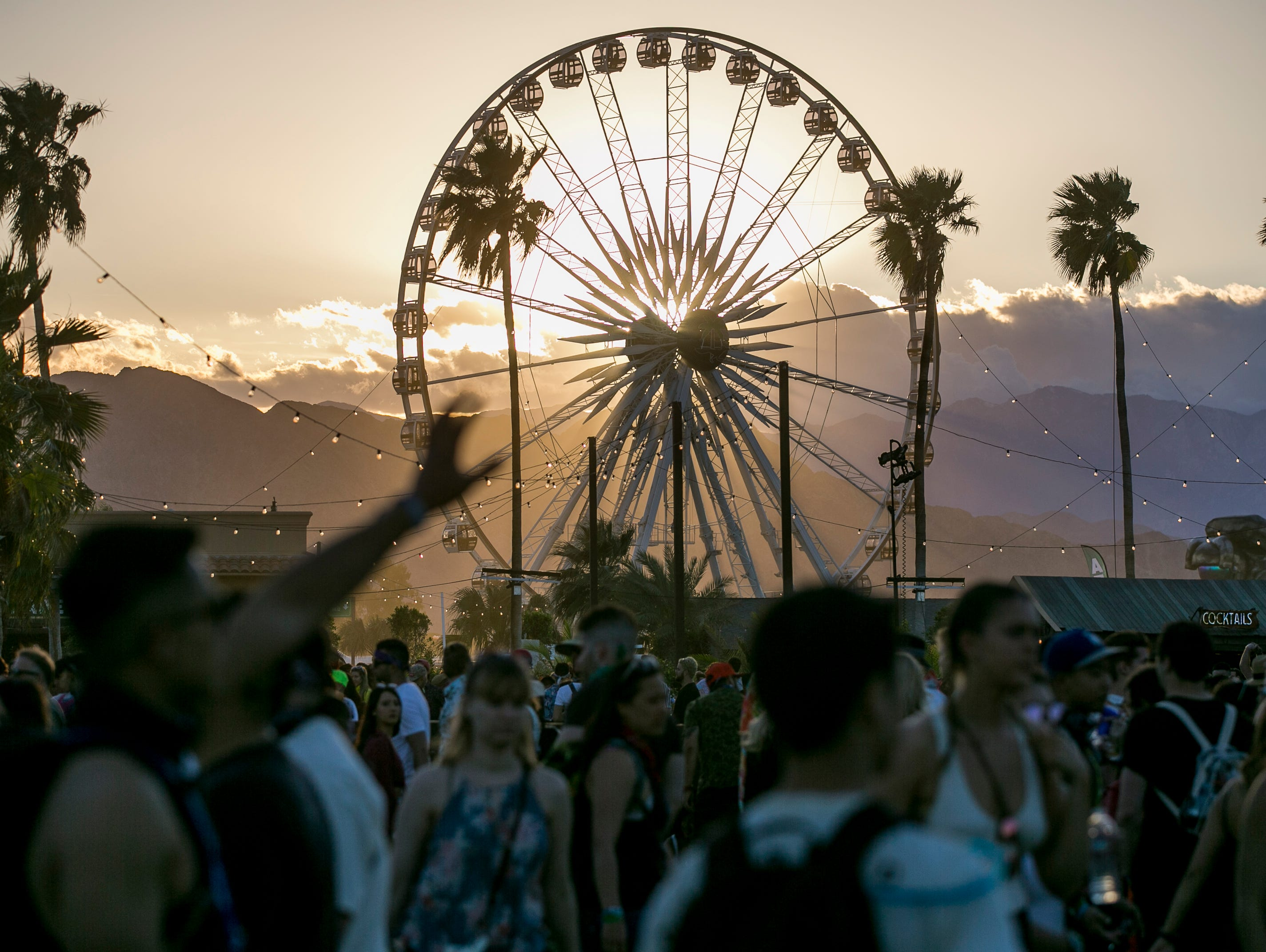 Festival goers walk on the grounds at the Coachella Valley Music and Arts Festival in Indio, Calif. on Fri. April 12, 2019.