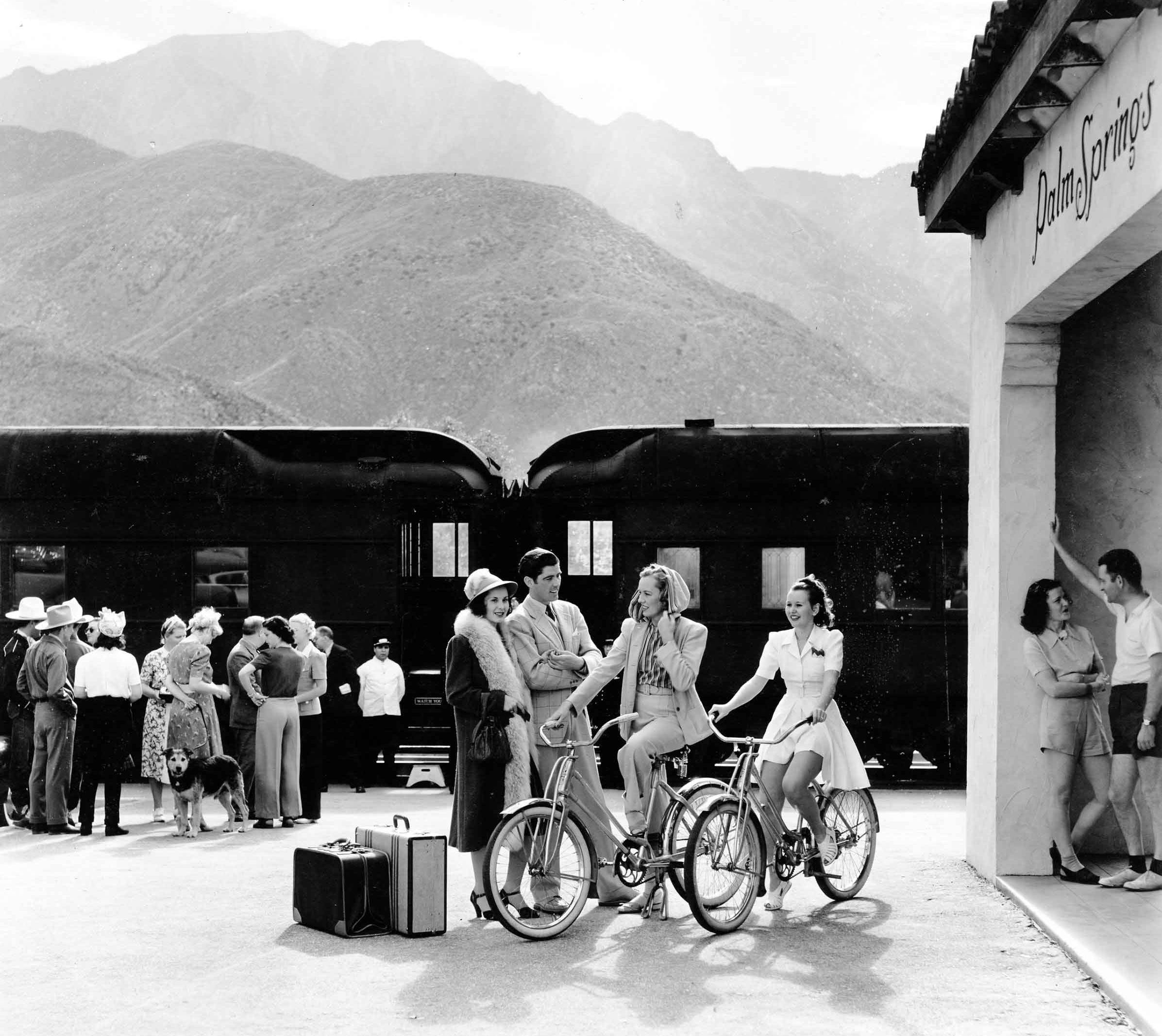 Palm Springs train depot in 1939 with I. Magnin store models posing for photographers.