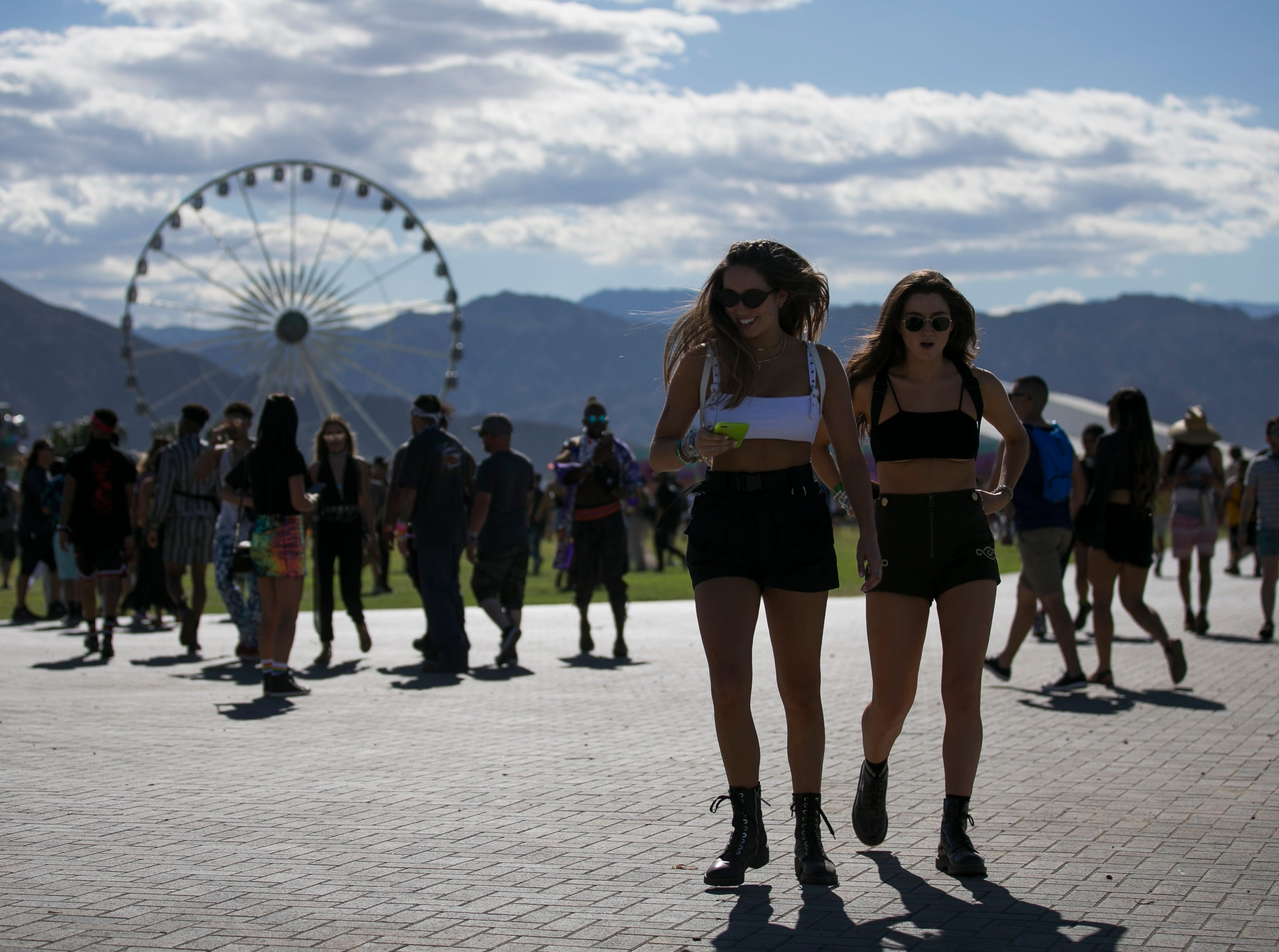 Shelby Silva (right) and Anna Arnett (left) walk through the grounds at the Coachella Valley Music and Arts Festival in Indio, Calif. on Fri. April 12, 2019.