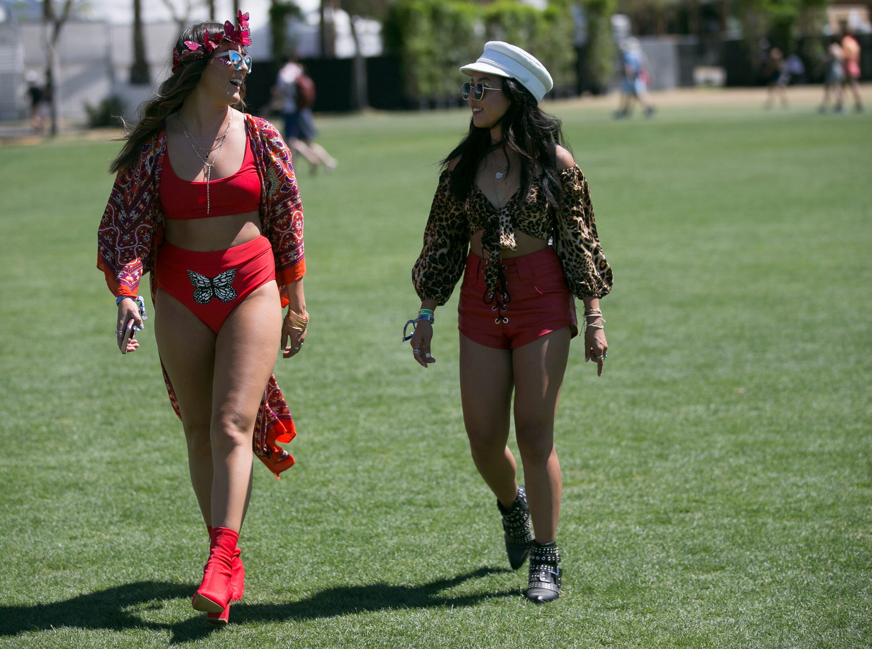 Ashley Prybycien (left) and Cathie Rattanakone (right) walk through the festival grounds at Coachella 2019 in Indio, Calif. on Sat. April 13, 2019.