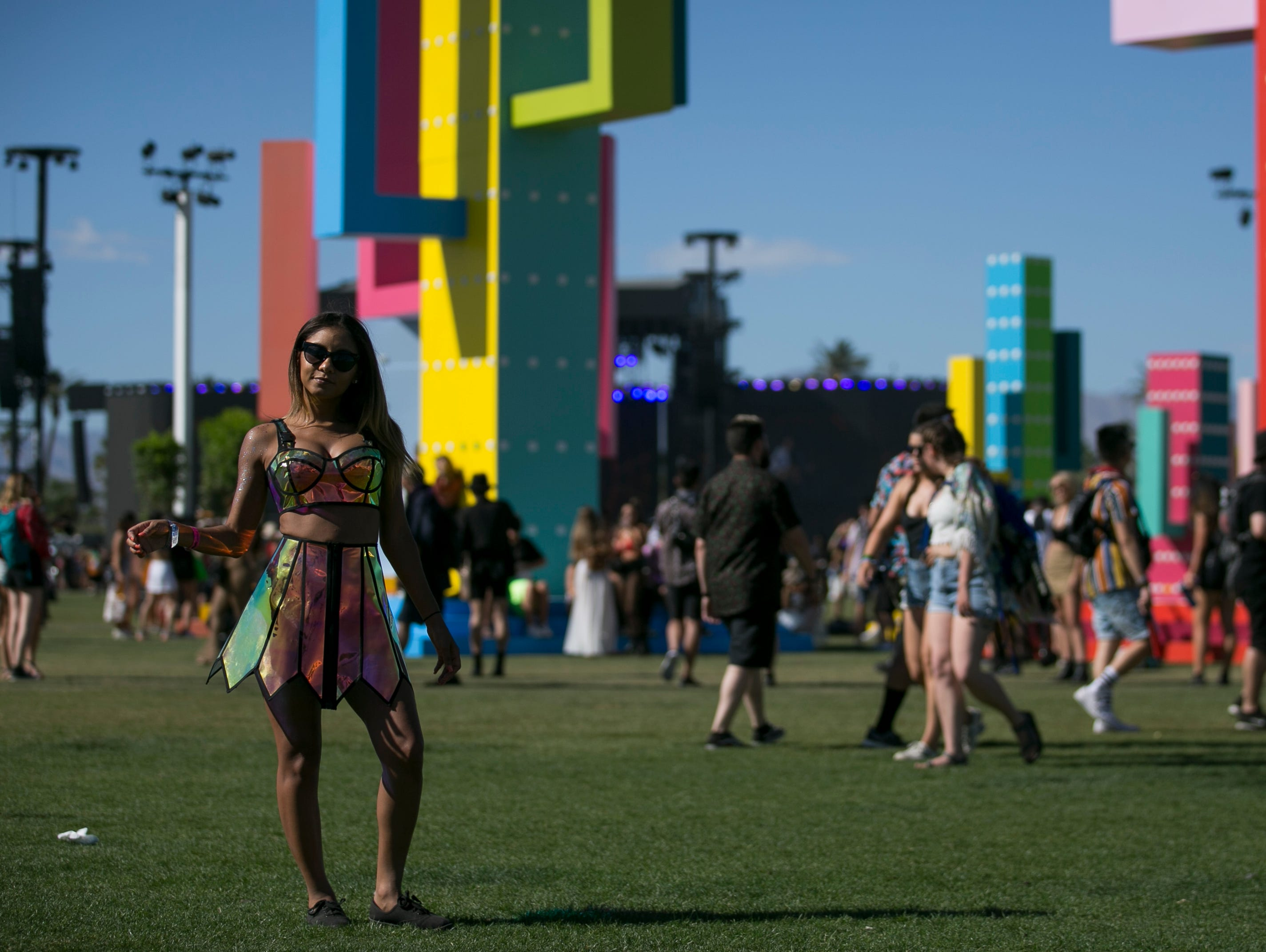 Mesly Casado, from Denver, poses in front of art installations at the Coachella Valley Music and Arts Festival in Indio, Calif. on Fri. April 12, 2019.