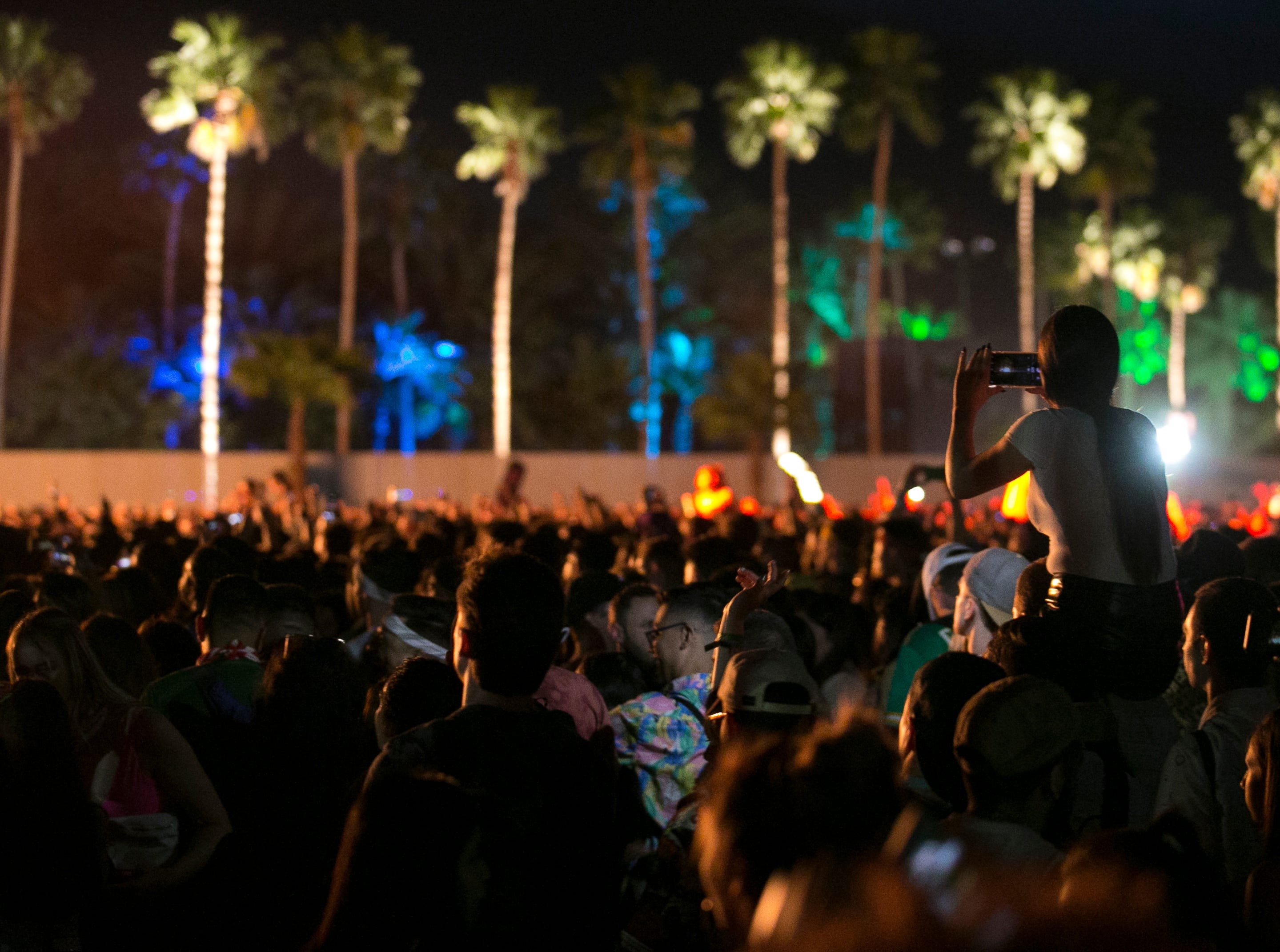 Festival goers watch DJ Snake perform at the Coachella Valley Music and Arts Festival in Indio, Calif. on Fri. April 12, 2019.