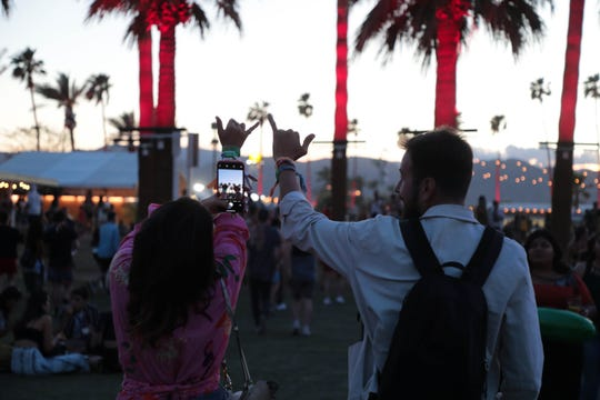A couple takes a photo at the Coachella Valley Music and Arts Festival on Friday, April 12, 2019 in Indio, Calif.