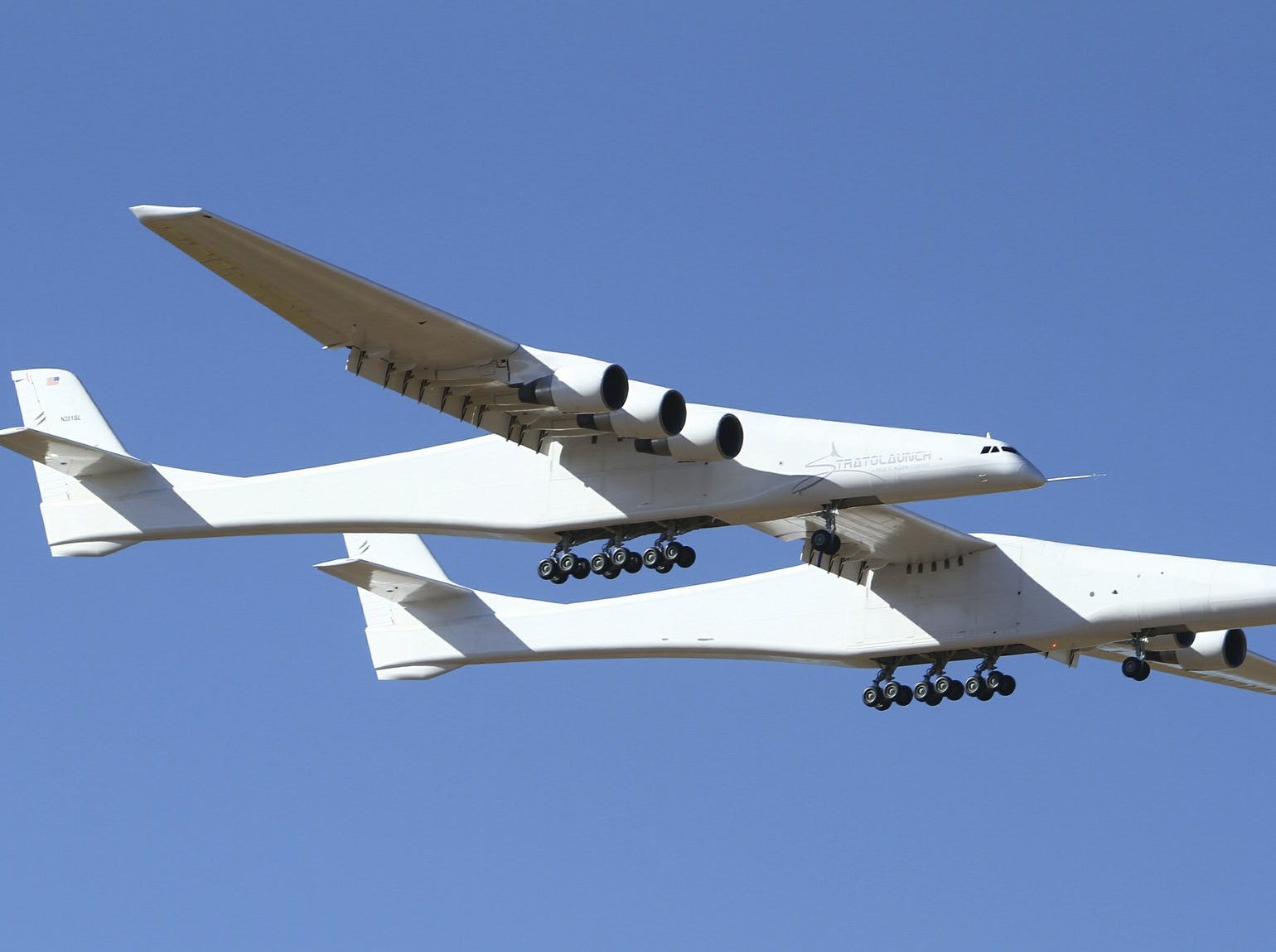 Stratolaunch, a giant six-engine aircraft with the world's longest wingspan , makes its historic first flight from the Mojave Air and Space Port in Mojave, Calif., Saturday, April 13, 2019. Founded by the late billionaire Paul G. Allen, Stratolaunch is vying to be a contender in the market for air-launching small satellites.