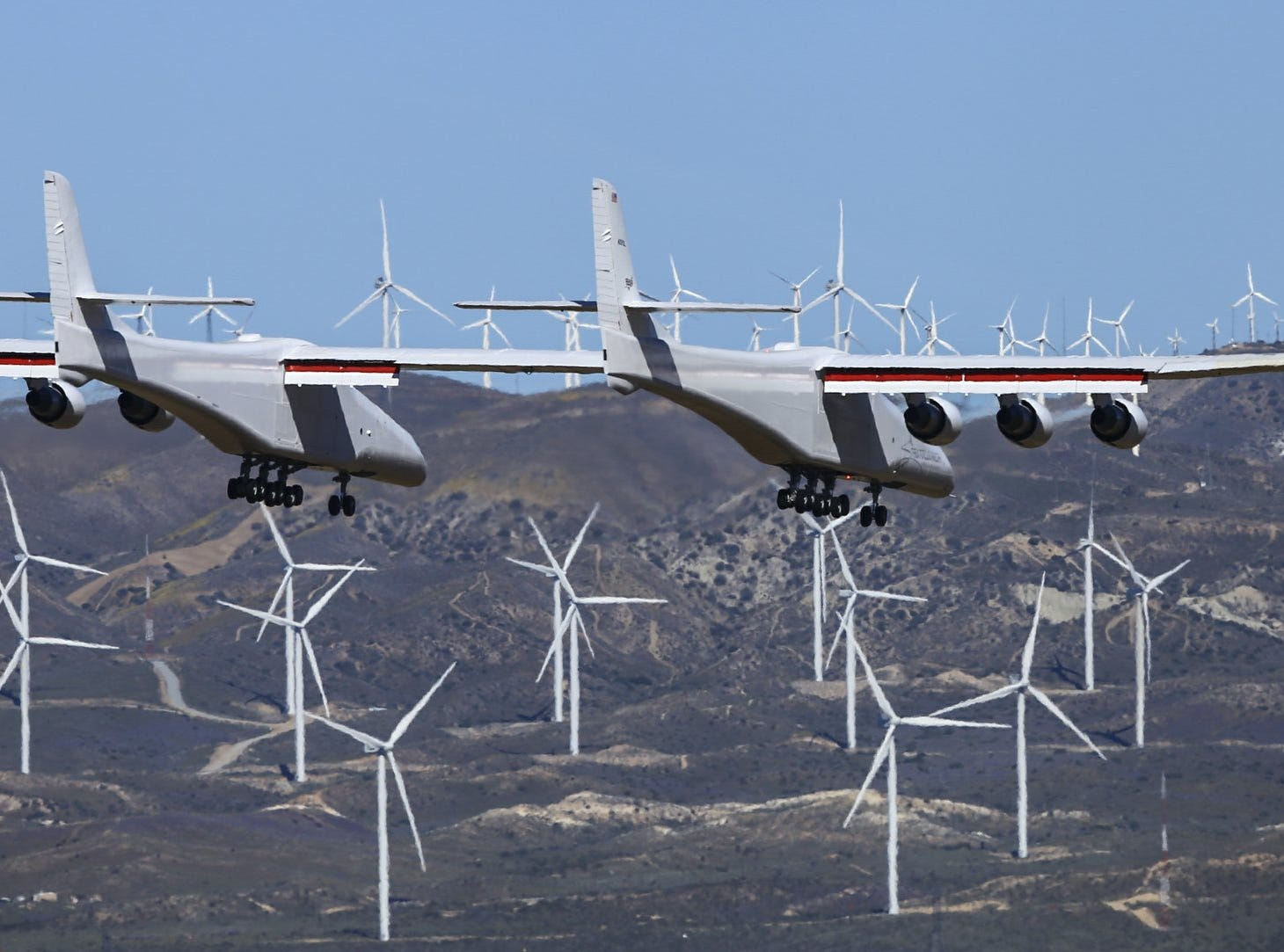 Stratolaunch, a giant six-engine aircraft with the world's longest wingspan, makes its historic first flight from the Mojave Air and Space Port in Mojave, Calif., Saturday, April 13, 2019. Founded by the late billionaire Paul G. Allen, Stratolaunch is vying to be a contender in the market for air-launching small satellites.