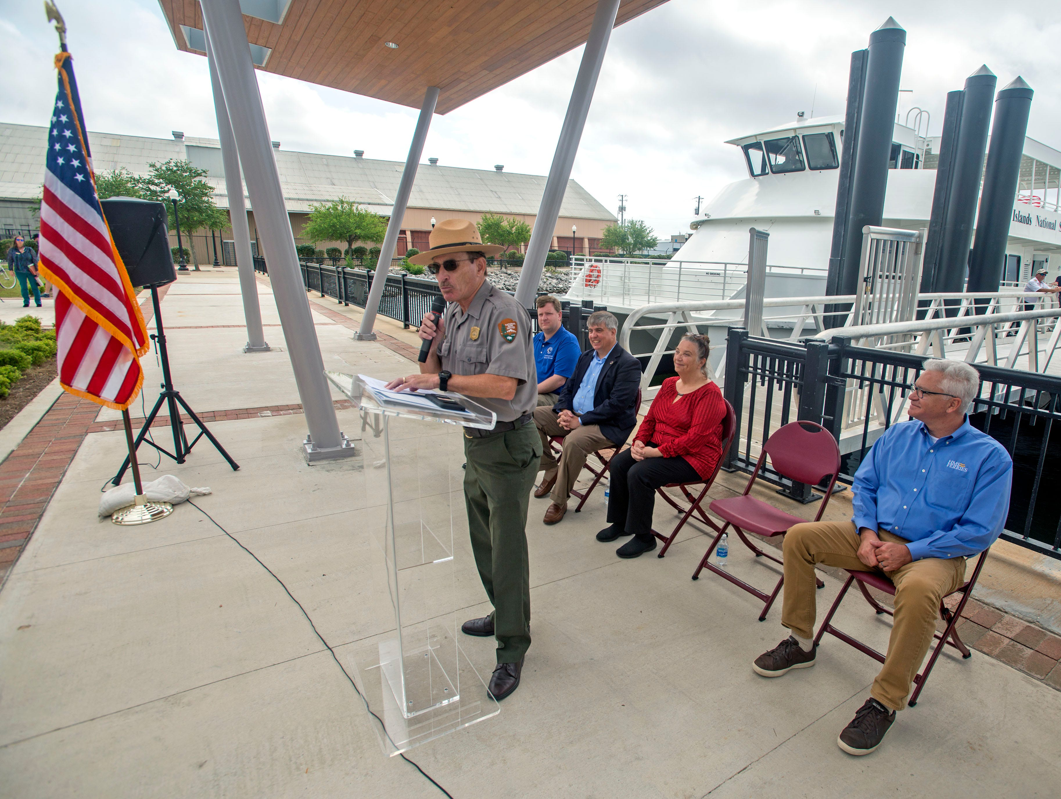 Dan Brown, superintendent with the National Park Service,, speaks during the City of Pensacola's Ferry Terminal Building Grand Opening and ribbon cutting Saturday, April 13, 2019.