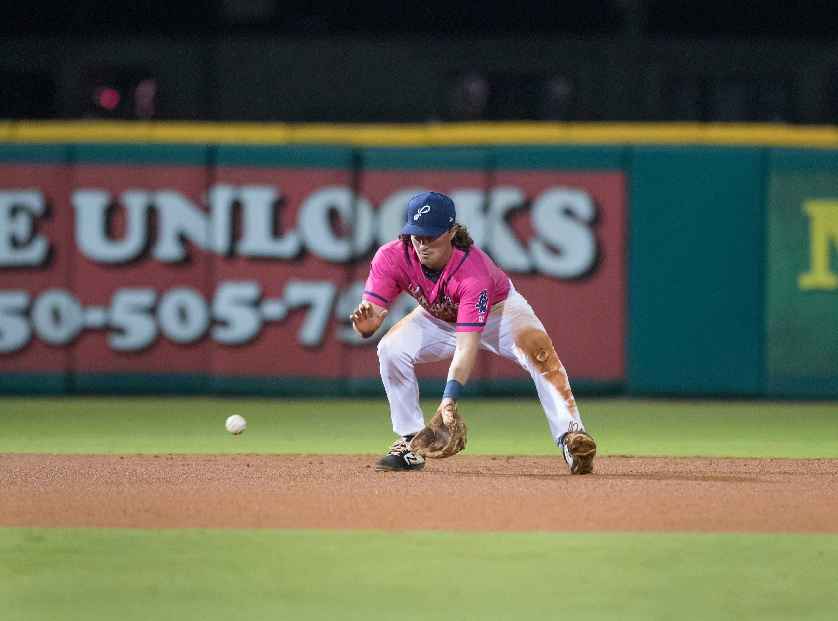 Shortstop Jordan Gore (10) scoops up a grounder for an out during the Jacksonville Jumbo Shrimp vs Pensacola Blue Wahoos baseball game in Pensacola on Friday, April 12, 2019.
