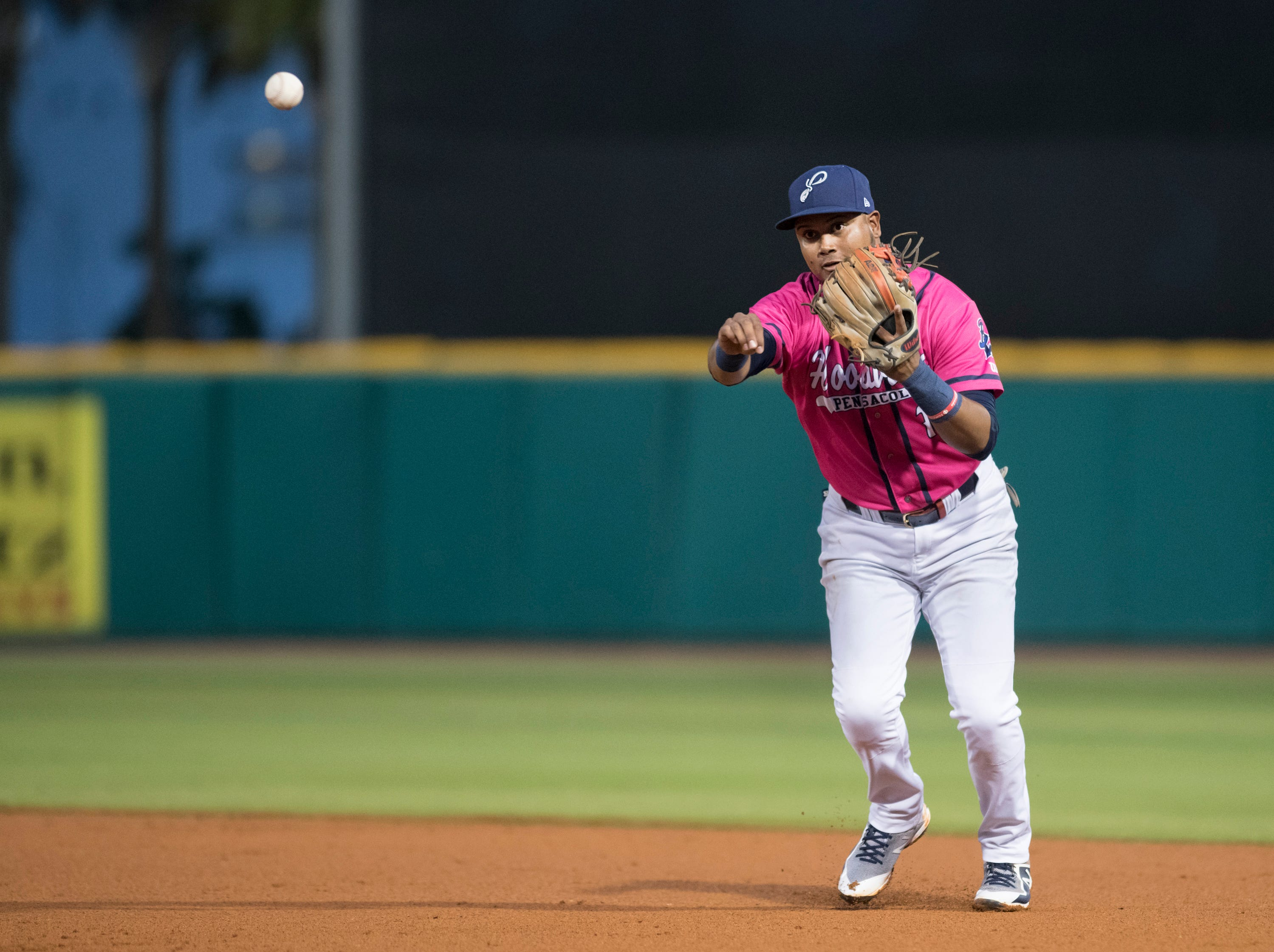 Second baseman Luis Arraez (1) tosses to first for an out during the Jacksonville Jumbo Shrimp vs Pensacola Blue Wahoos baseball game in Pensacola on Friday, April 12, 2019.