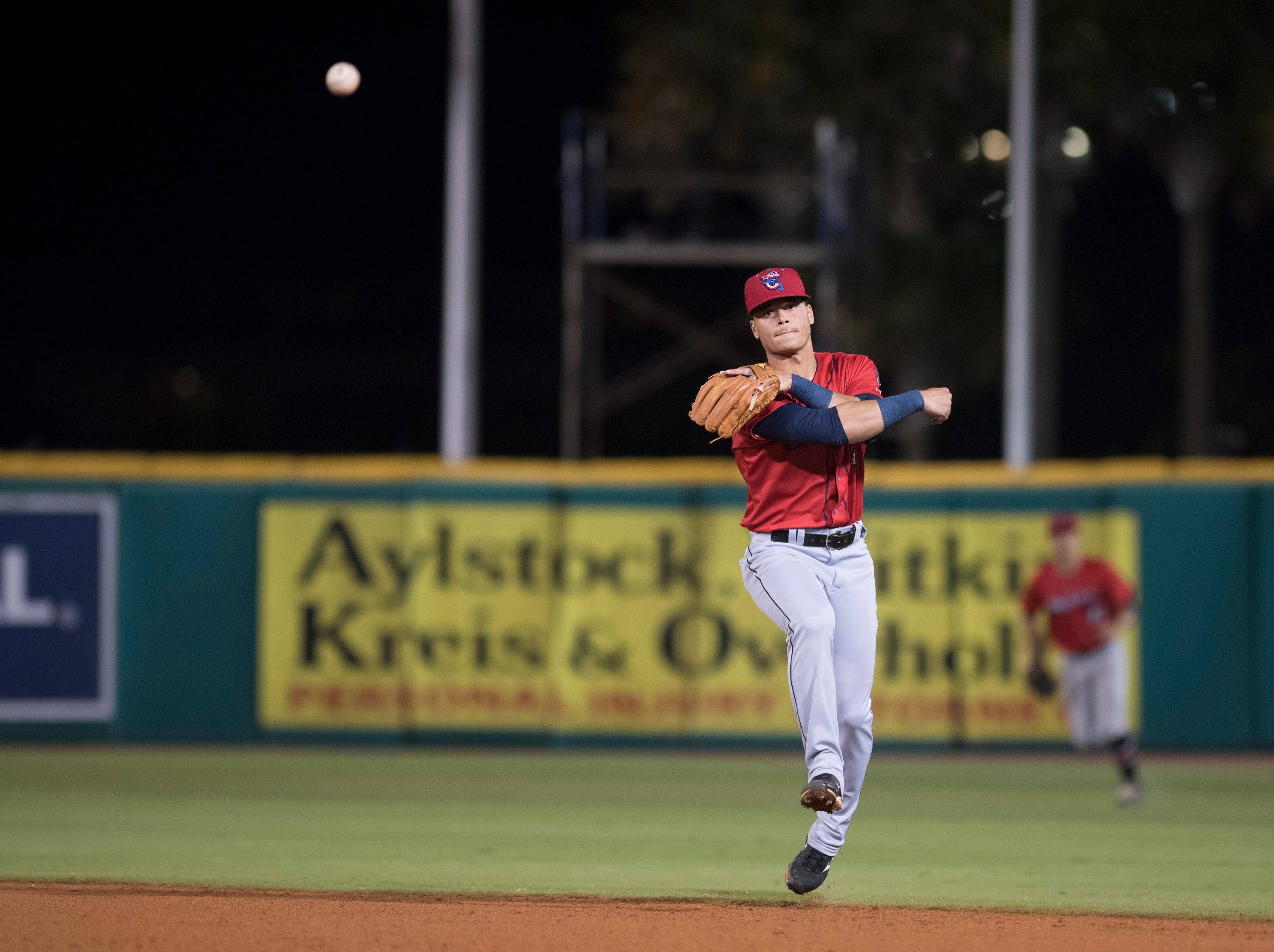 Second baseman Bryson Brigman (6) throws to first base for an out during the Jacksonville Jumbo Shrimp vs Pensacola Blue Wahoos baseball game in Pensacola on Friday, April 12, 2019.