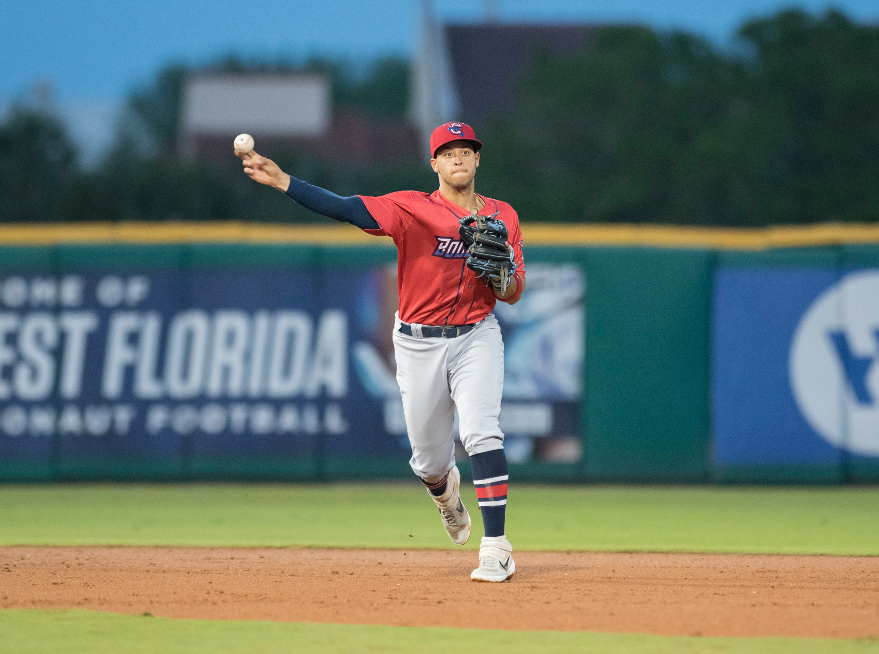 Shortstop Joe Dunand (3) tosses to first for an out during the Jacksonville Jumbo Shrimp vs Pensacola Blue Wahoos baseball game in Pensacola on Friday, April 12, 2019.
