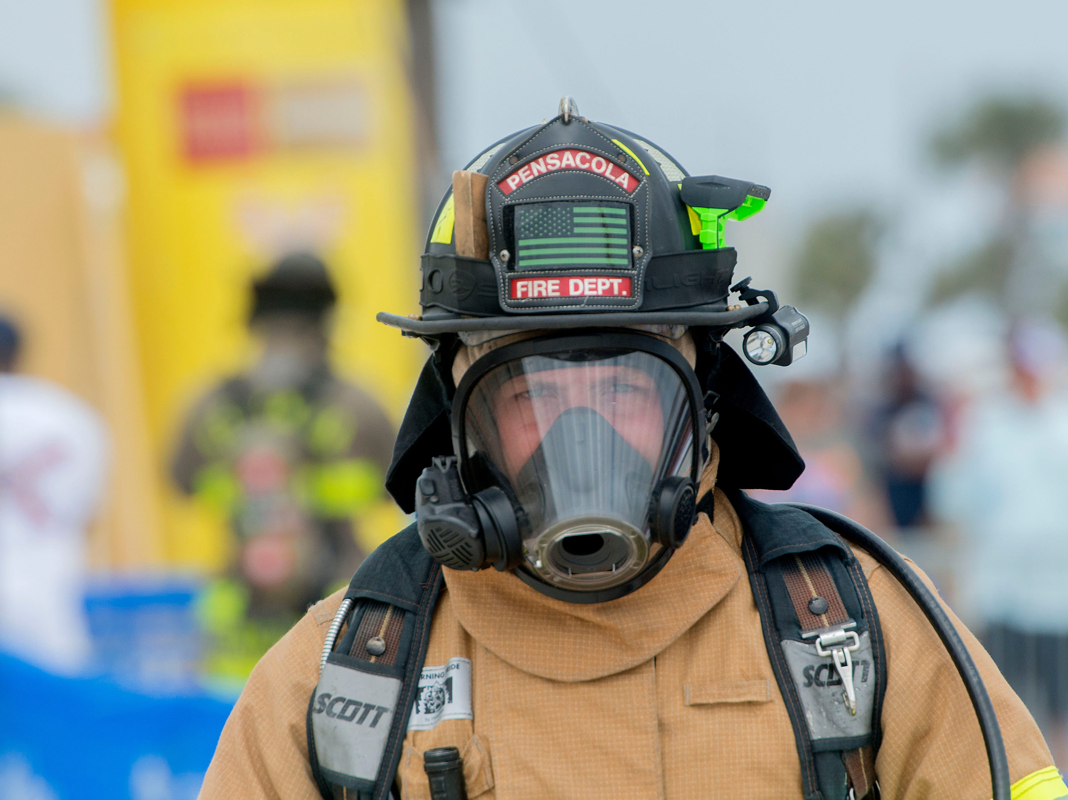 Firefighters compete during the fifth annual Pensacola Beach Firefighters Challenge. The event tested the strength, agility, teamwork, and skills of firefighters as well as provided a fun, family friendly event for participants and the public.