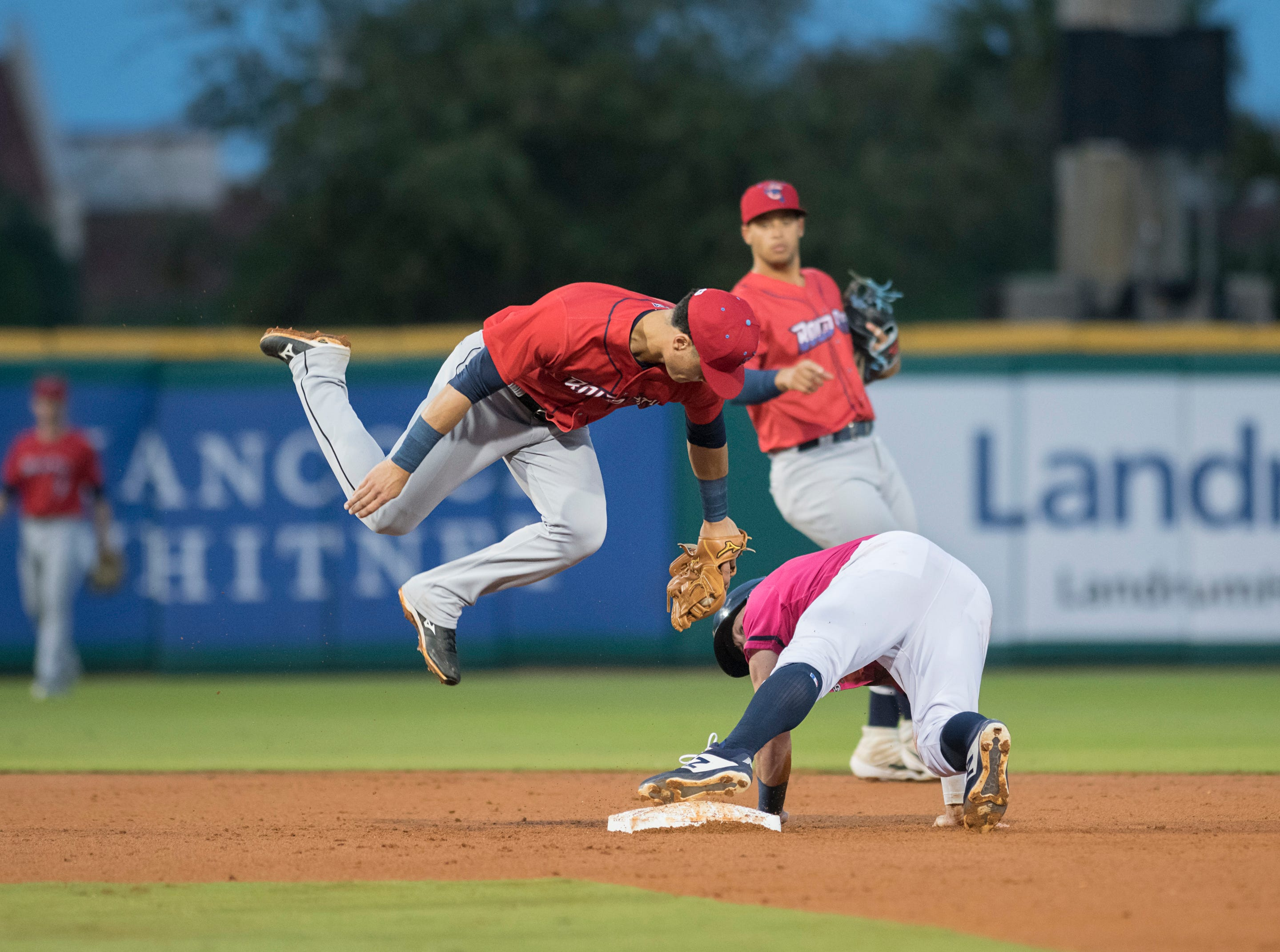 Jimmy Kerrigan (12) safely steals second base ahead of the throw to Bryson Brigman (6) during the Jacksonville Jumbo Shrimp vs Pensacola Blue Wahoos baseball game in Pensacola on Friday, April 12, 2019.