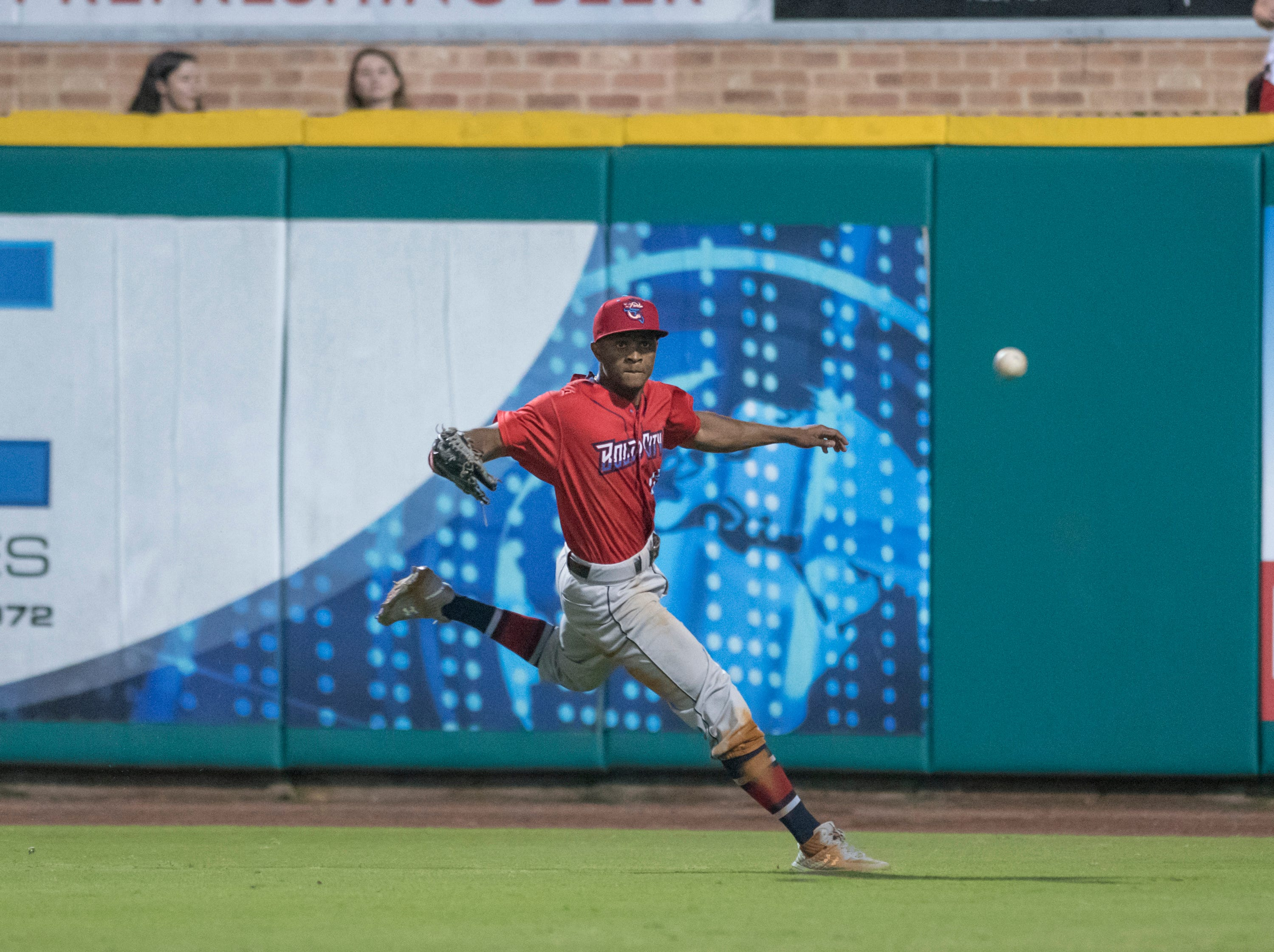 Magneuris Sierra (18) tracks down Drew Maggi (15)'s looper into right field before catching him too far off first for the last out of the inning during the Jacksonville Jumbo Shrimp vs Pensacola Blue Wahoos baseball game in Pensacola on Friday, April 12, 2019.