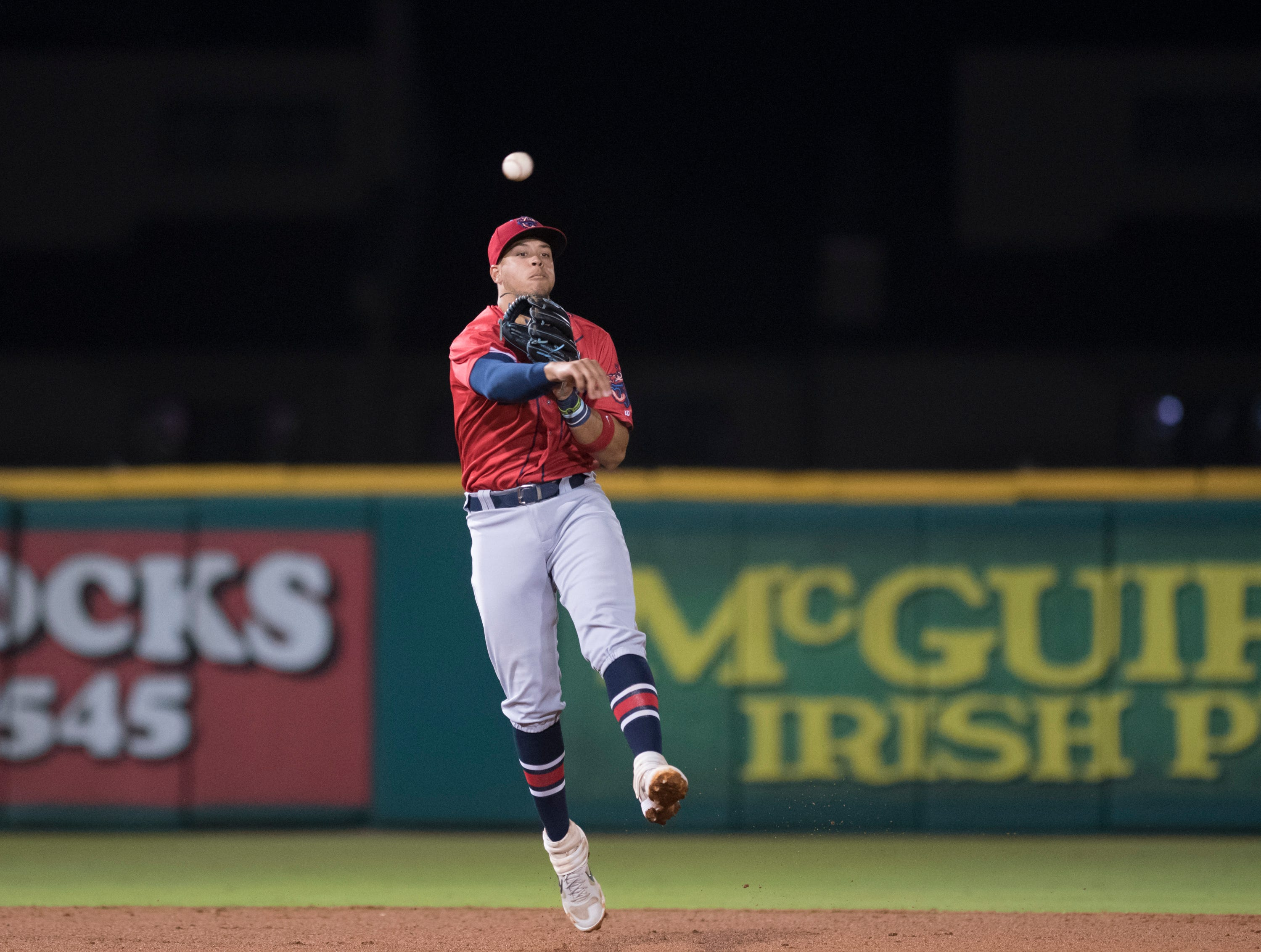 Shortstop Joe Dunand (3) fires to first for an out during the Jacksonville Jumbo Shrimp vs Pensacola Blue Wahoos baseball game in Pensacola on Friday, April 12, 2019.