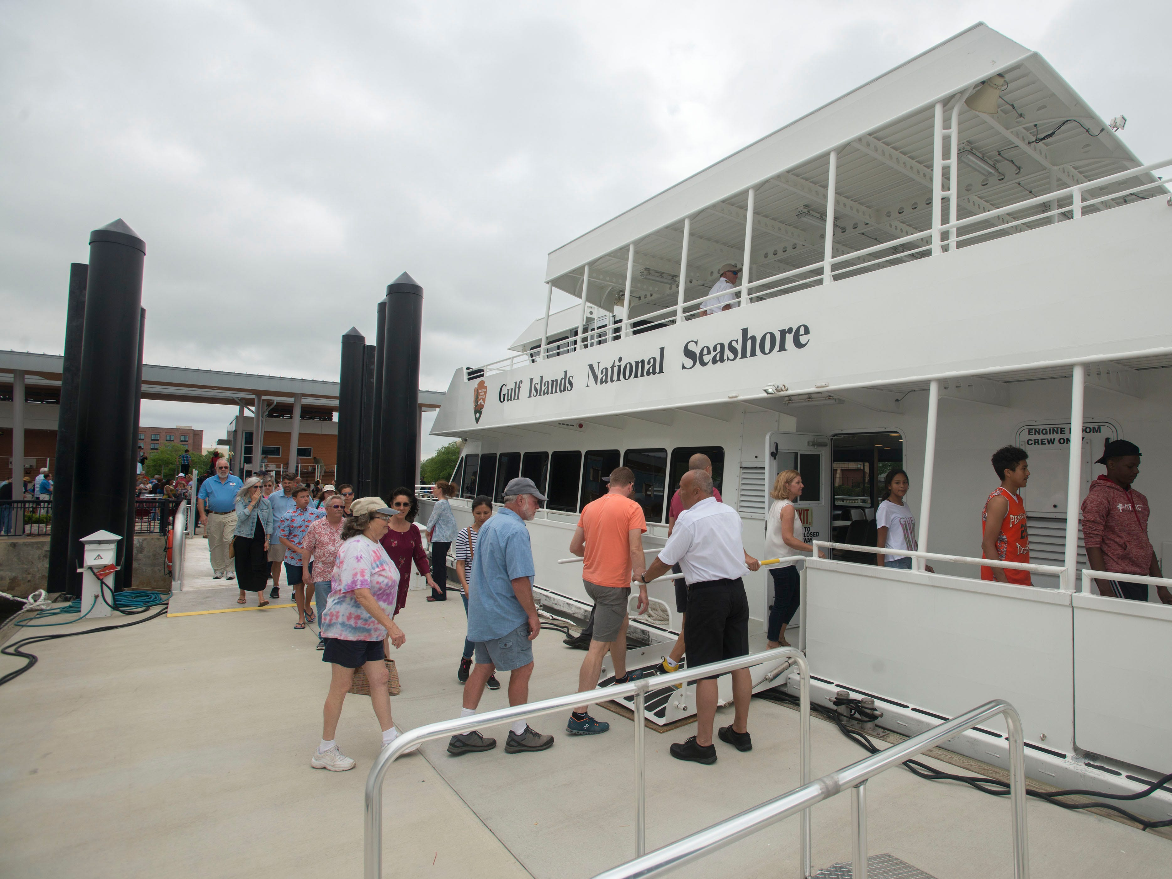 Visitors gather during the City of Pensacola's Ferry Terminal Building Grand Opening and ribbon cutting Saturday, April 13, 2019.