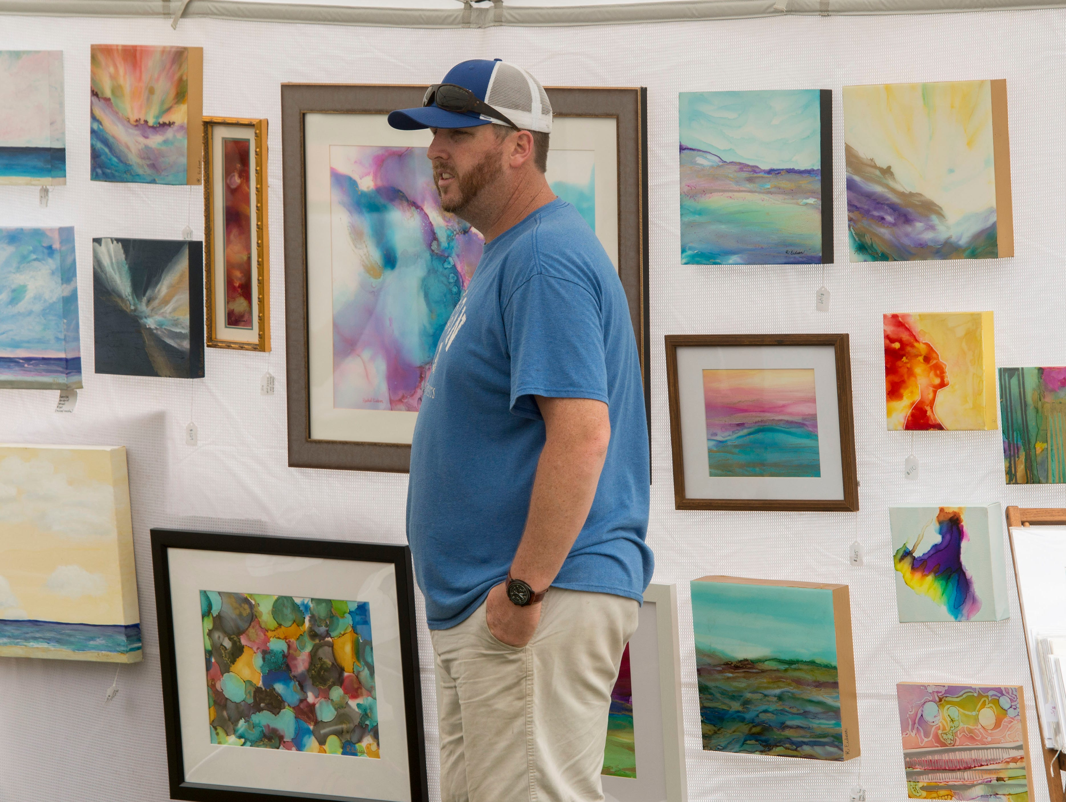 Visitors enjoy Art on the Green Saturday, April 13, 2019 at the Pensacola Country Club Tennis Center. Art on the Green is an exciting one-day arts festival that aims to increase awareness and acceptance of the talents and gifts of individuals with autism along the Gulf Coast. The event  included artists from across the region and nation, including artists with autism. The family-friendly event included a Kid Zone, performing arts stage, and artist vendor booths.Funds raised by this event directly benefit the mission and programs of Autism Pensacola, Inc.