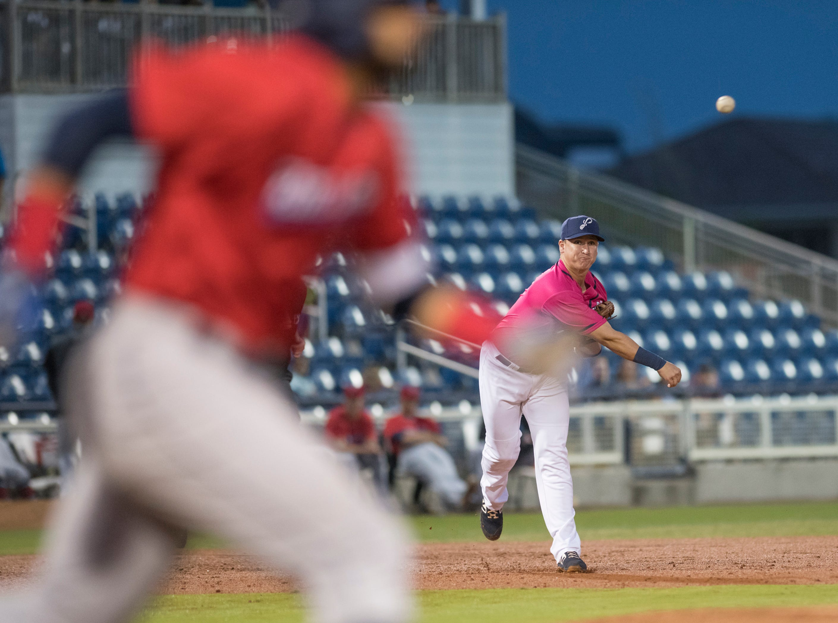 Third baseman Brian Schales (9) fires to first for an out during the Jacksonville Jumbo Shrimp vs Pensacola Blue Wahoos baseball game in Pensacola on Friday, April 12, 2019.