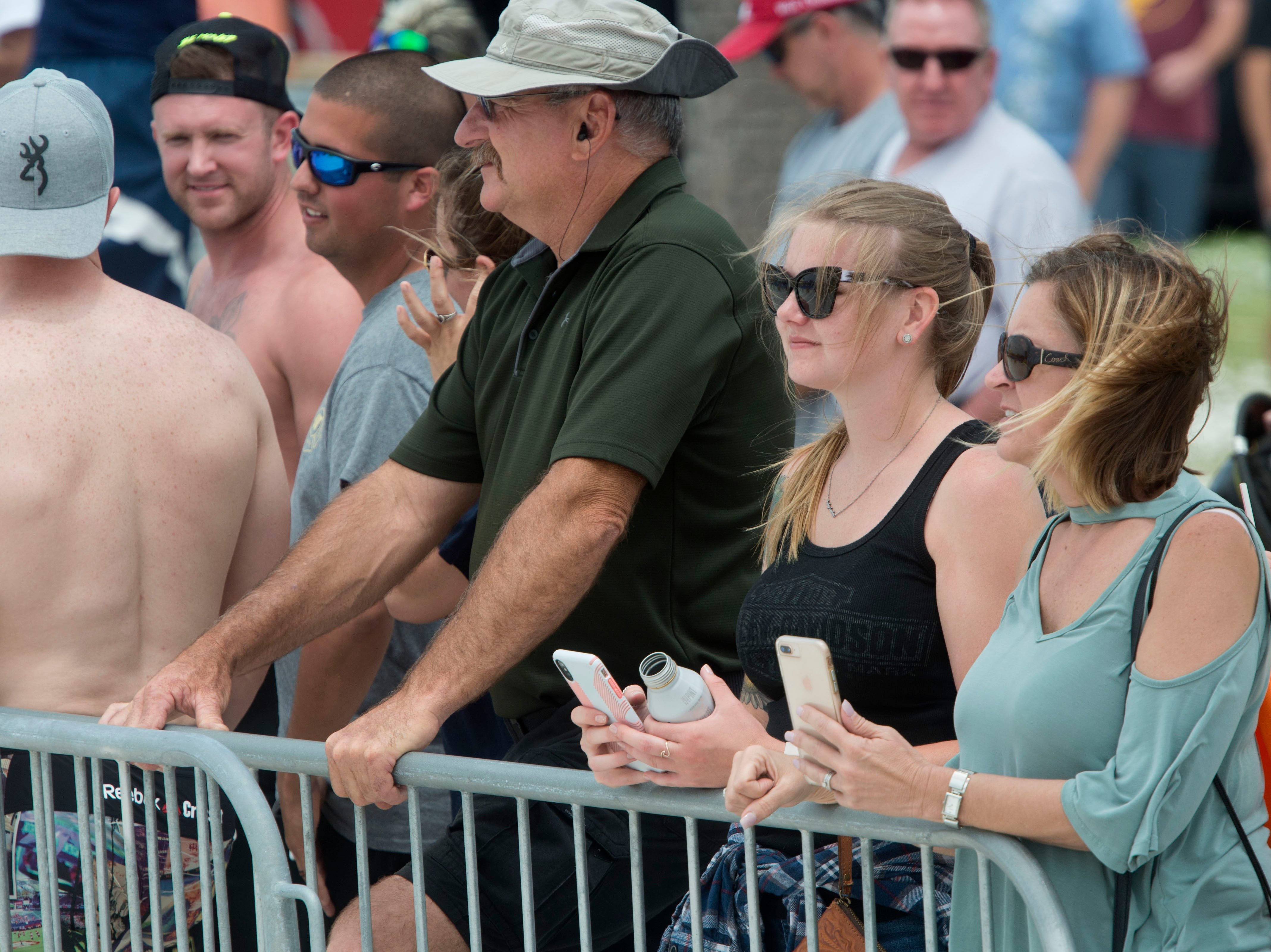 The crowd checks out firefighters competing during the fifth annual Pensacola Beach Firefighters Challenge. The event tested the strength, agility, teamwork, and skills of firefighters as well as provided a fun, family friendly event for participants and the public.