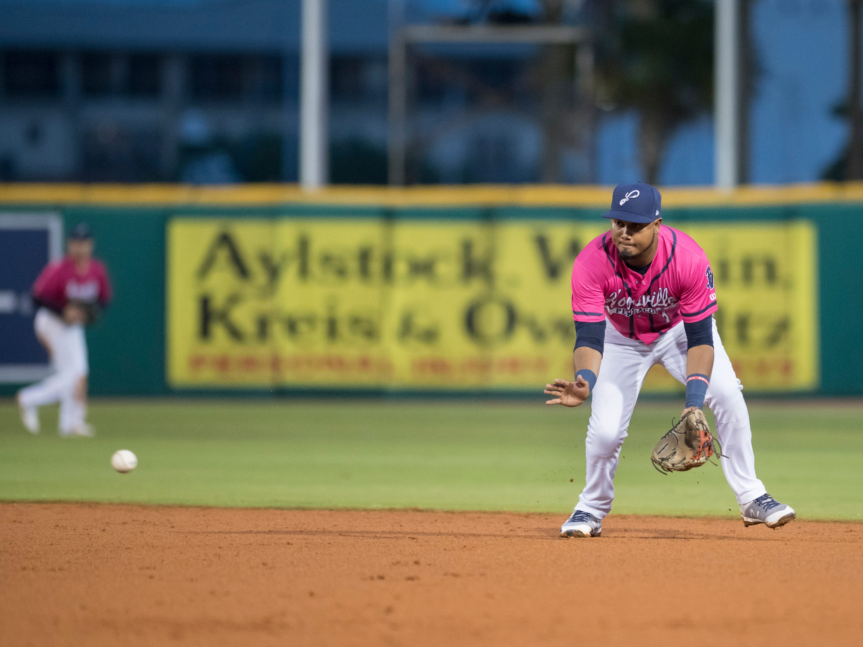 Second baseman Luis Arraez (1) fields a grounder for an out during the Jacksonville Jumbo Shrimp vs Pensacola Blue Wahoos baseball game in Pensacola on Friday, April 12, 2019.