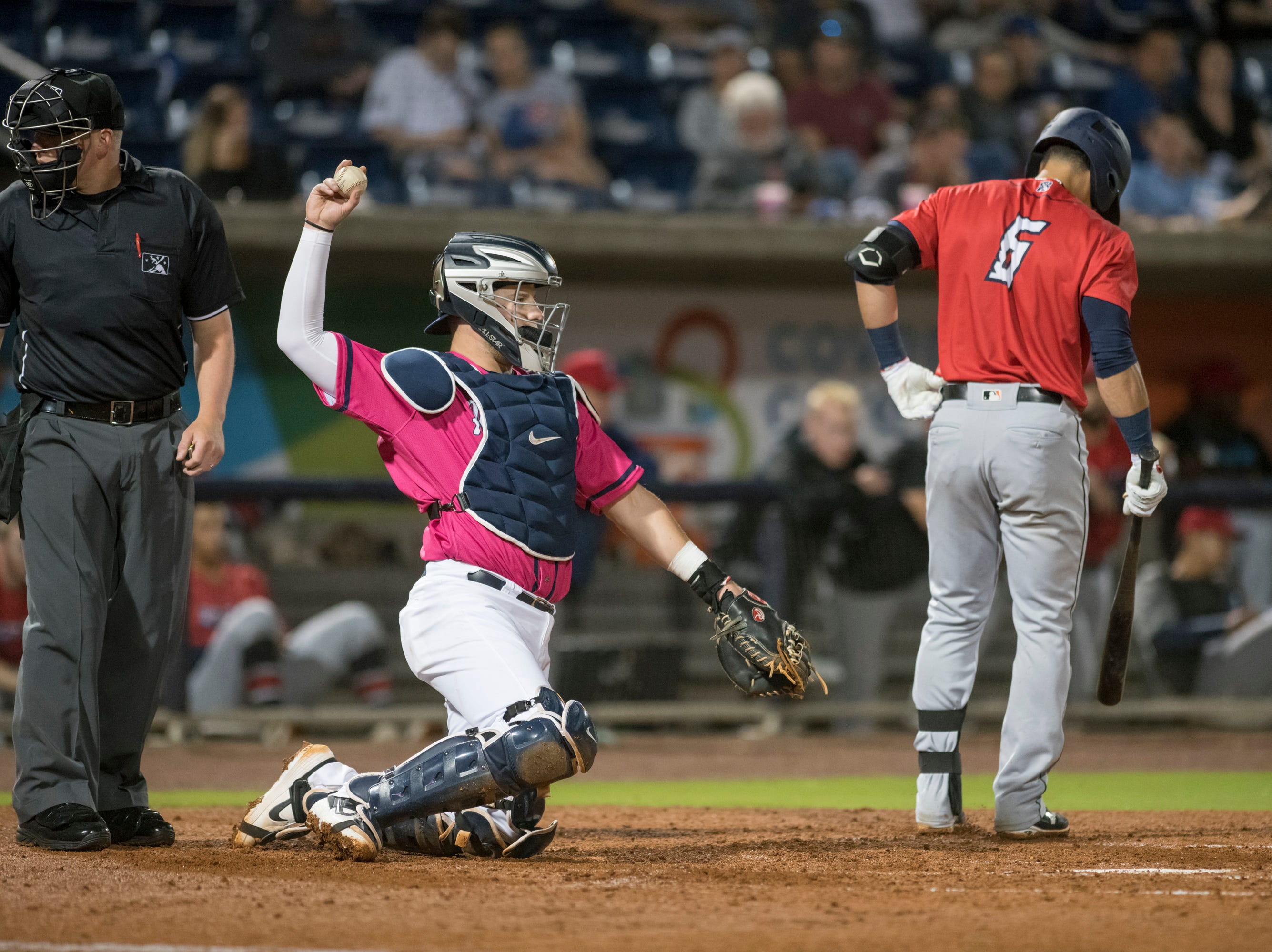 Caleb Hamilton (24) catches during the Jacksonville Jumbo Shrimp vs Pensacola Blue Wahoos baseball game in Pensacola on Friday, April 12, 2019.