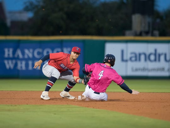 Shortstop Joe Dunand (3) tags out Tanner English (4) as he tries to steal second base during the Jacksonville Jumbo Shrimp vs Pensacola Blue Wahoos baseball game in Pensacola on Friday, April 12, 2019.