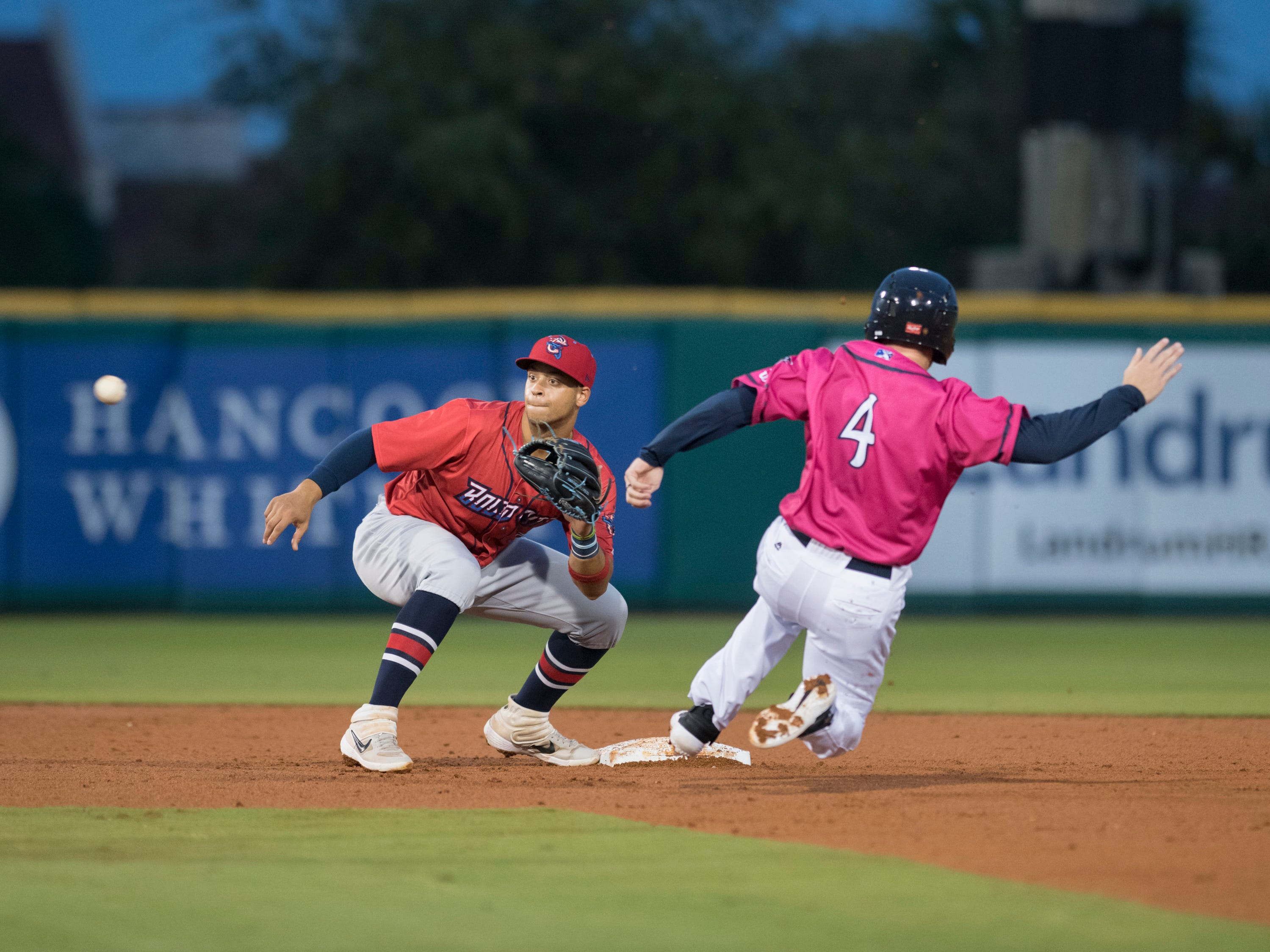 Shortstop Joe Dunand (3) gets the throw to tag out Tanner English (4) as he tries to steal second base during the Jacksonville Jumbo Shrimp vs Pensacola Blue Wahoos baseball game in Pensacola on Friday, April 12, 2019.